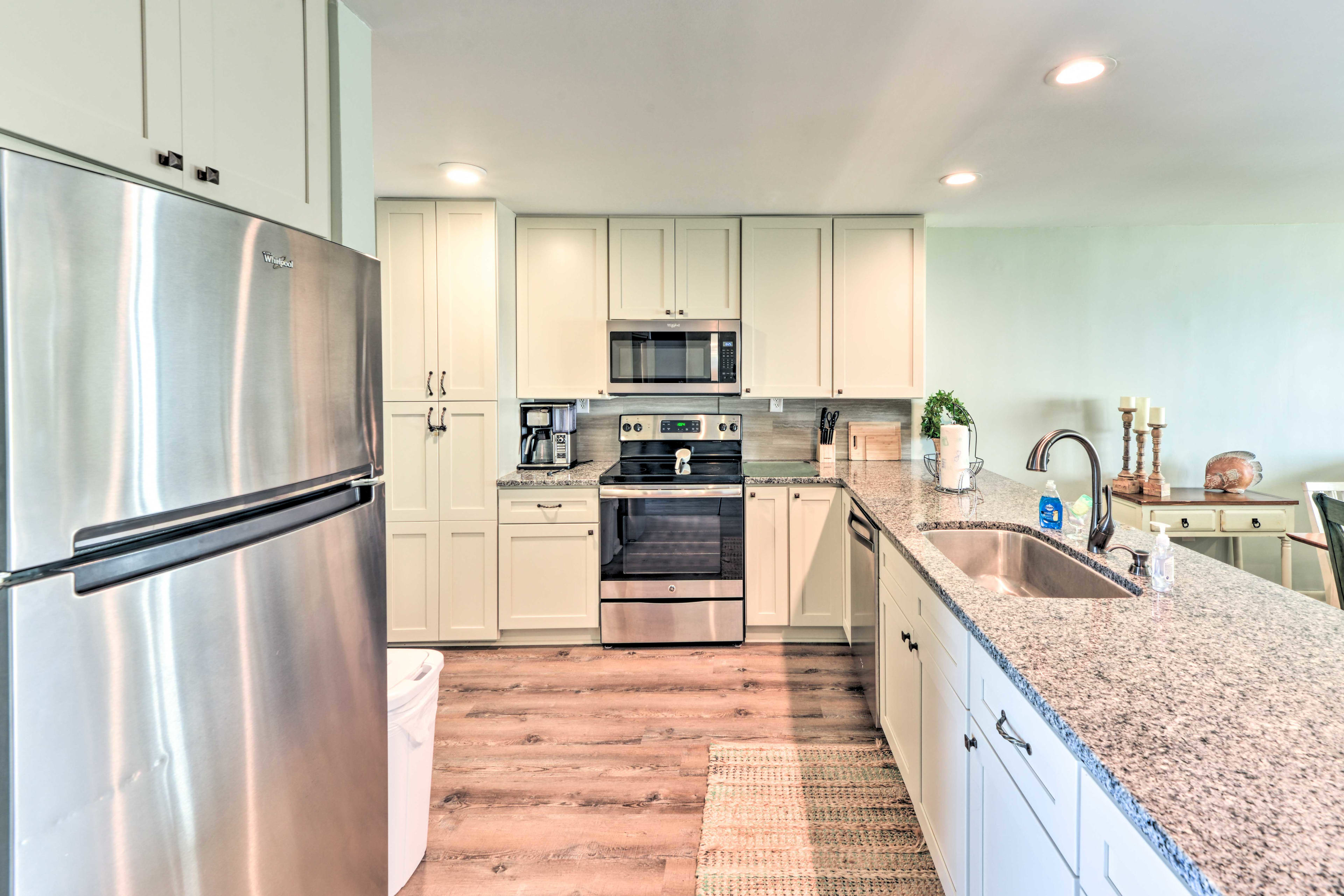 Utilize stainless steel appliances and granite countertops as you cook!