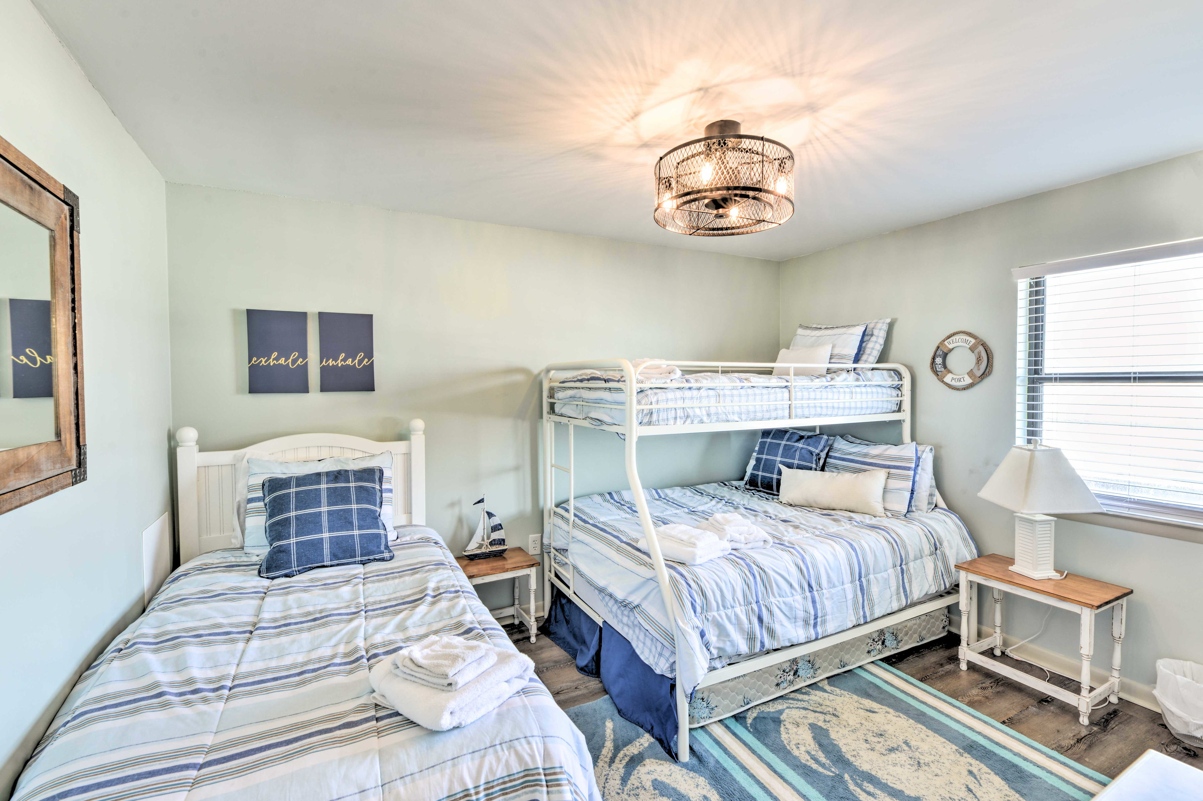 This bedroom offers 2 twin-sized beds and 2 full-sized beds.