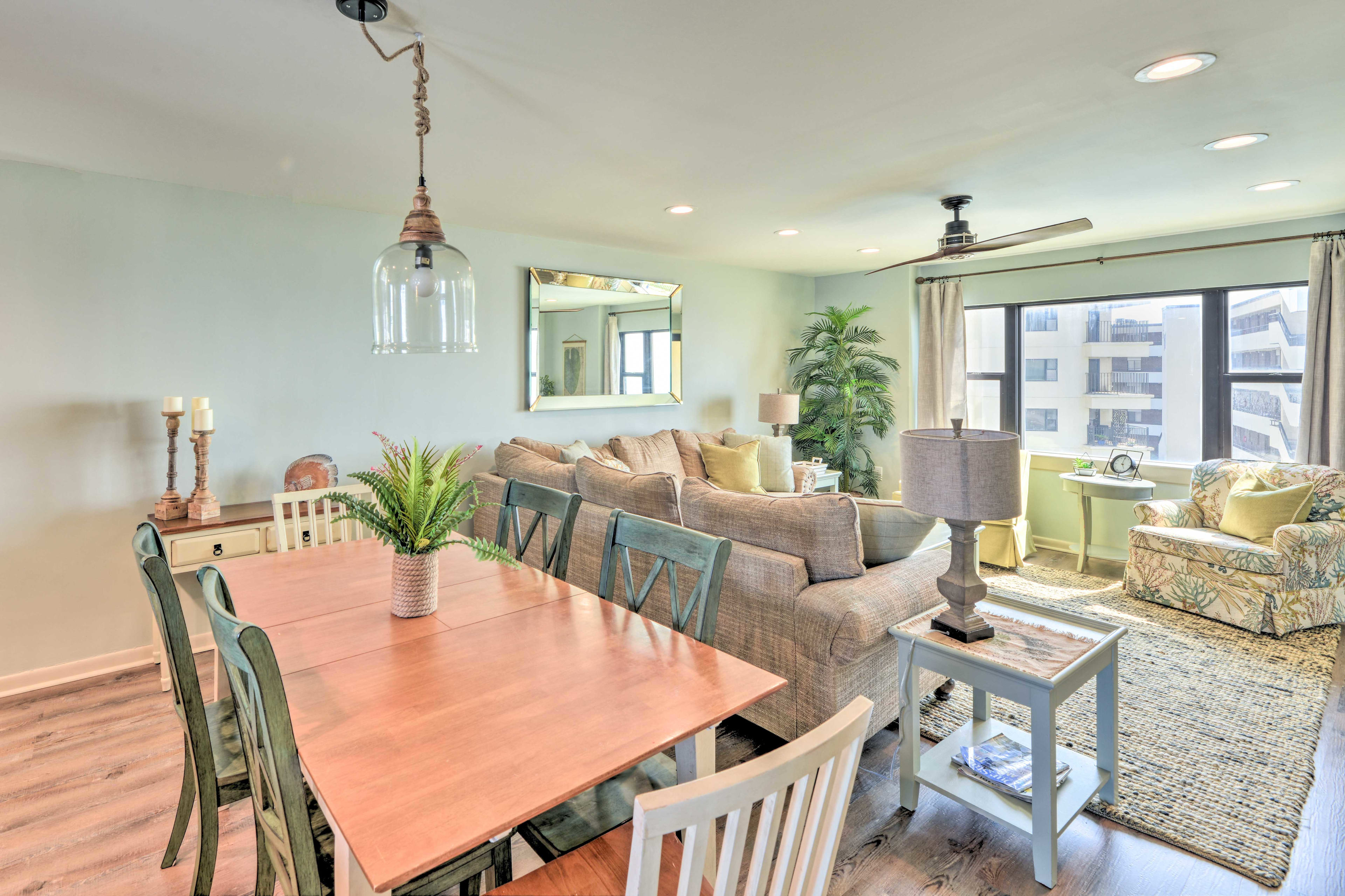 Set the large wooden dining table for a memorable family-style feast.