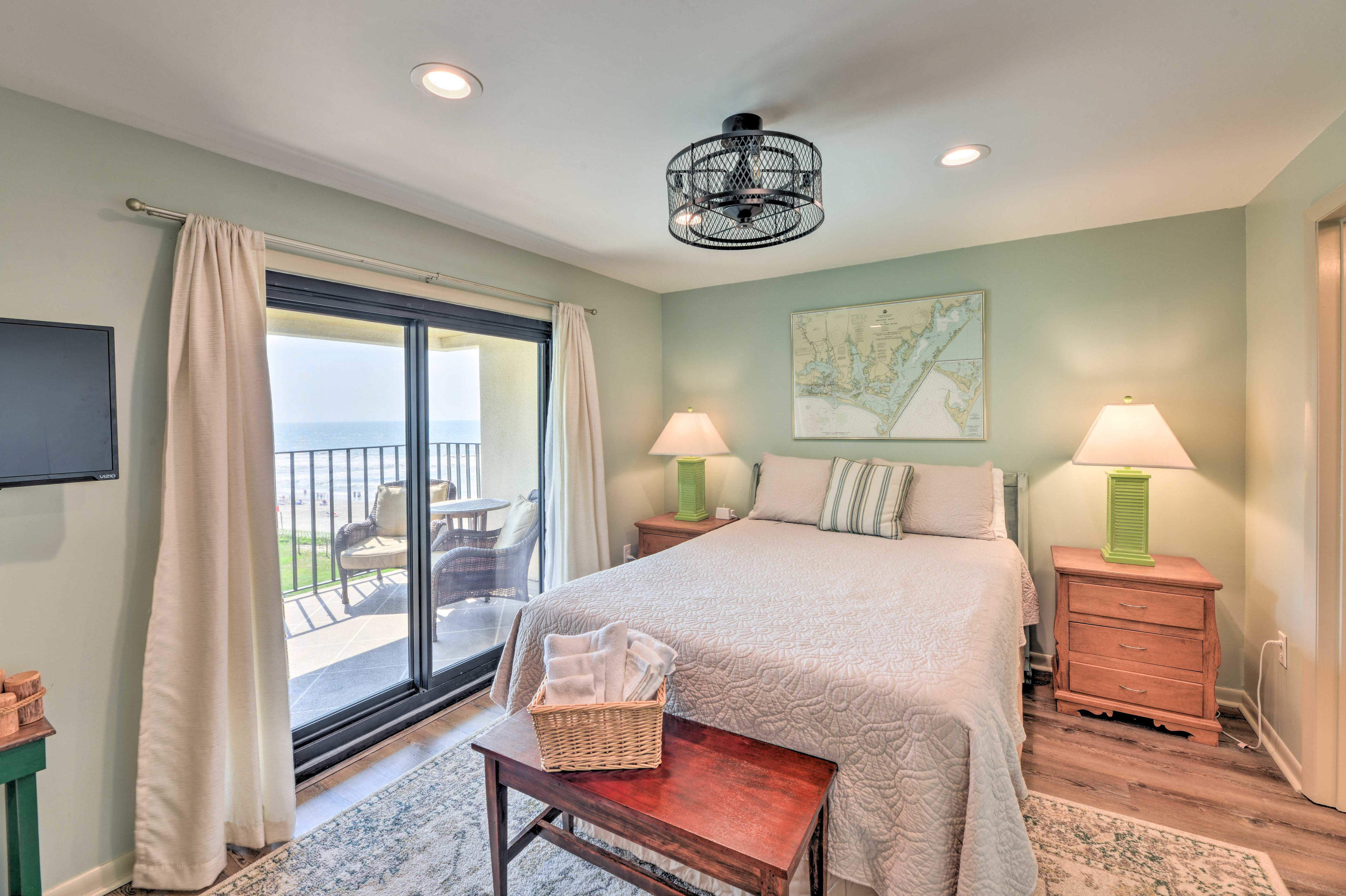 The master bedroom has a queen-sized bed and private balcony access.