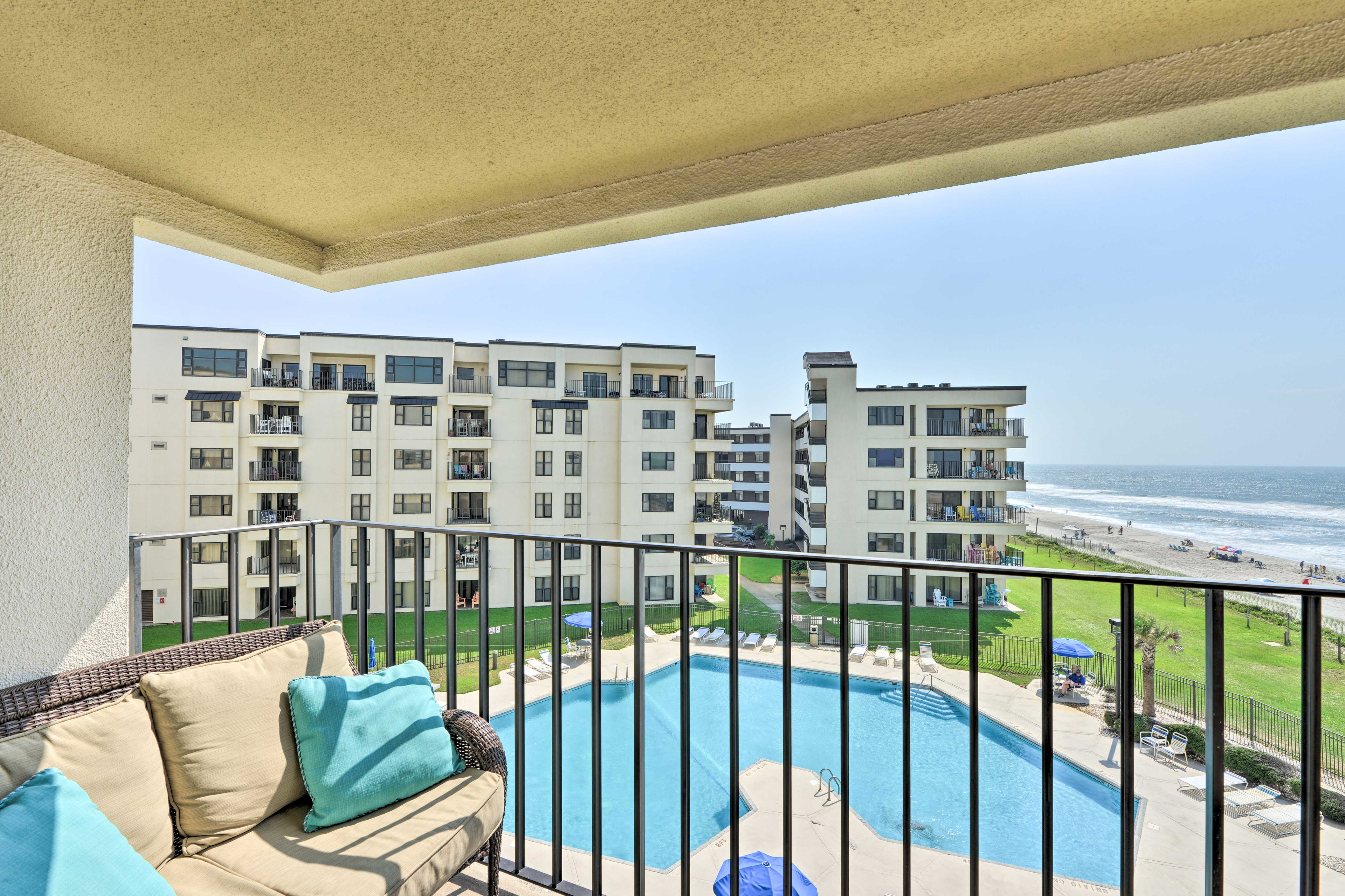 Step outside to enjoy the vibrant sunshine and stunning views of the beach!