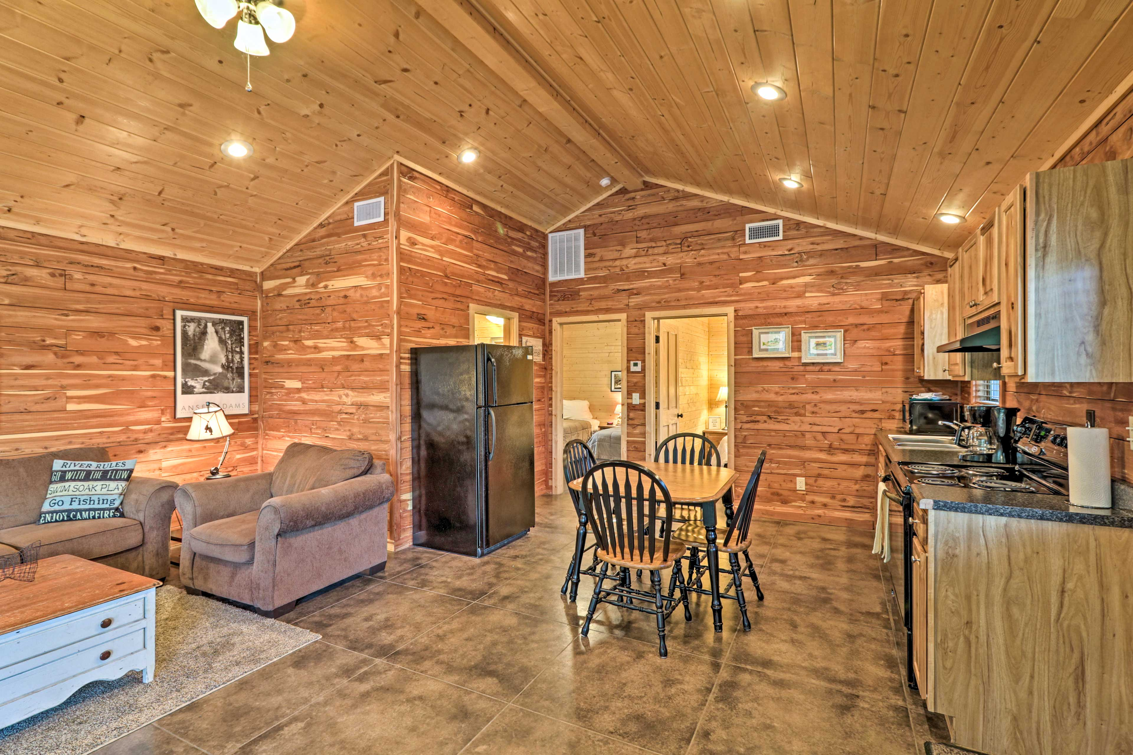 High ceilings and wood siding highlight the living area.