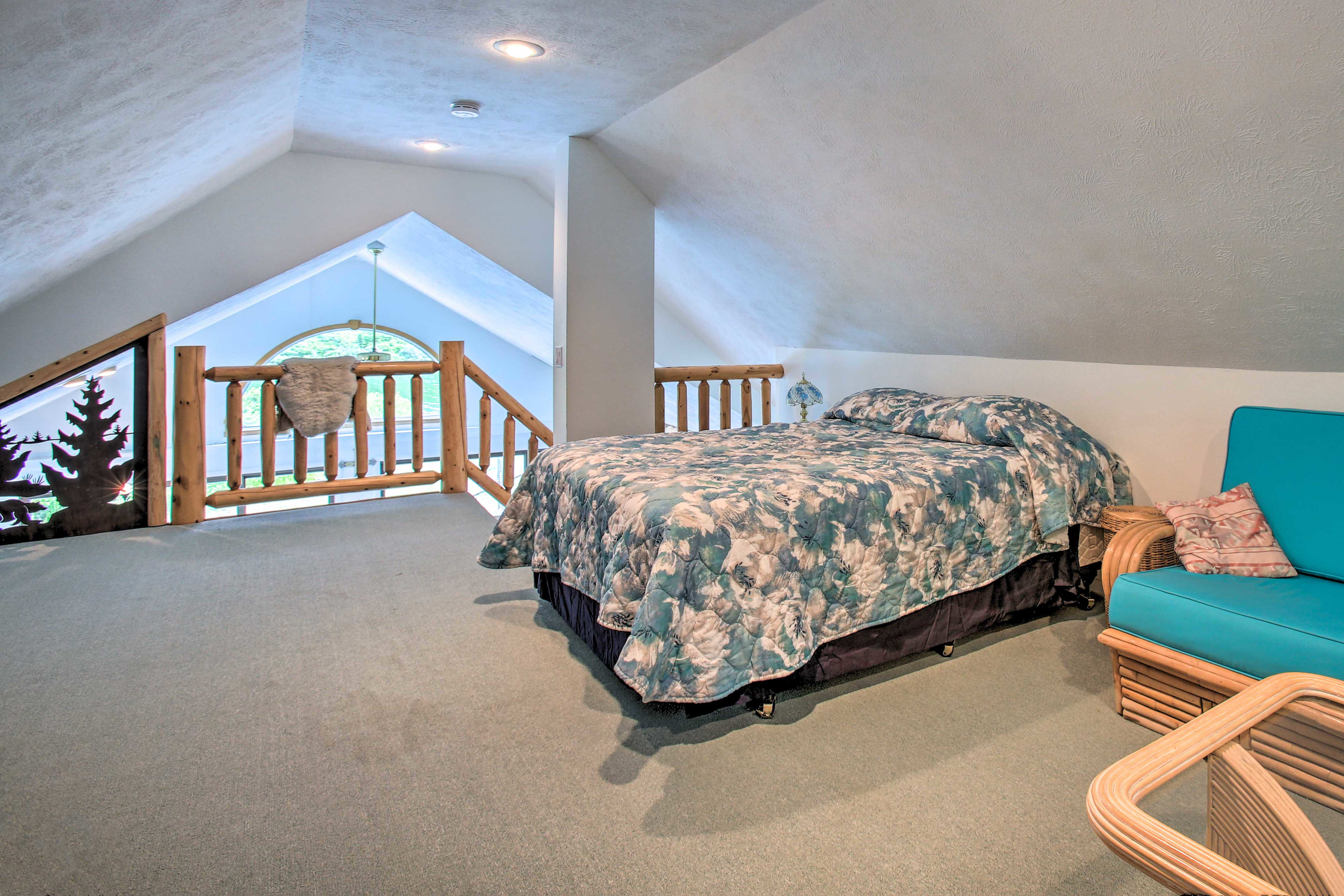 This room has a queen bed and a sleeper sofa.