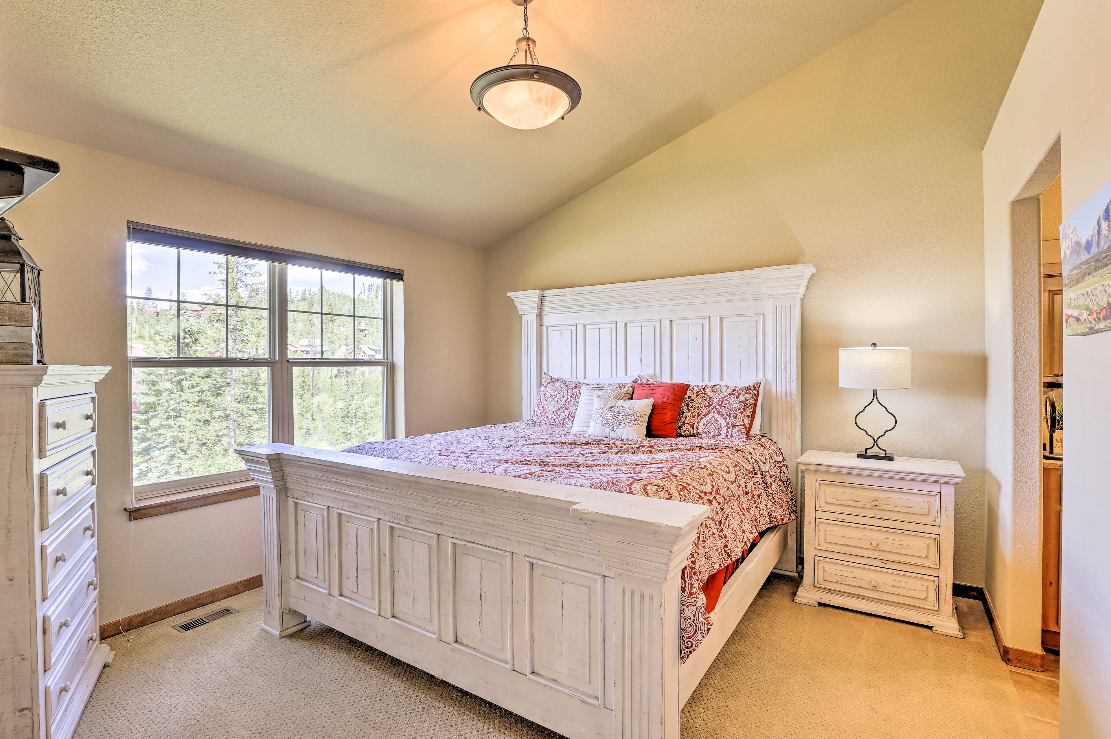Curl up under the covers of this king-sized bed in the master bedroom!