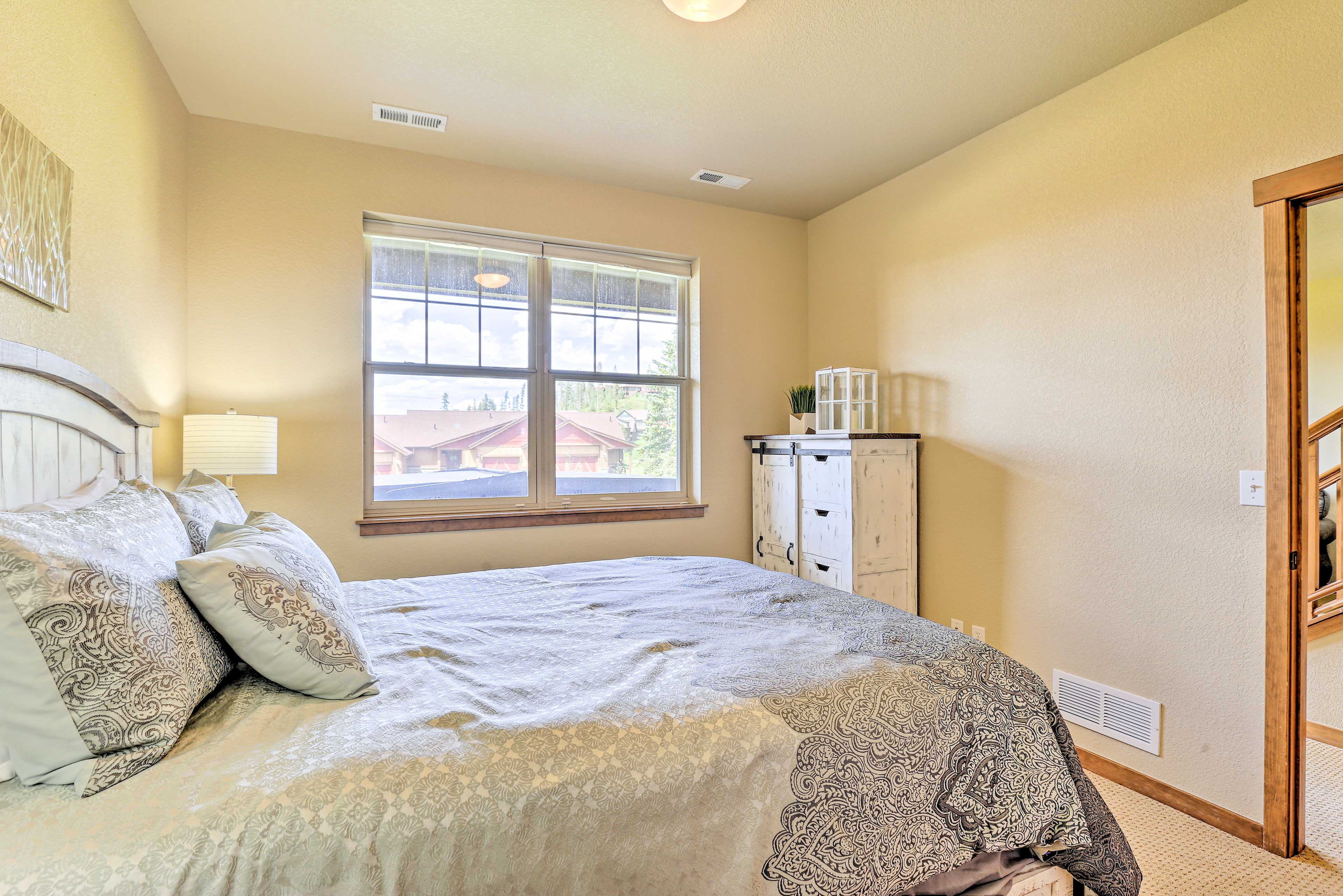 Move yourself into this second bedroom with views out the window.