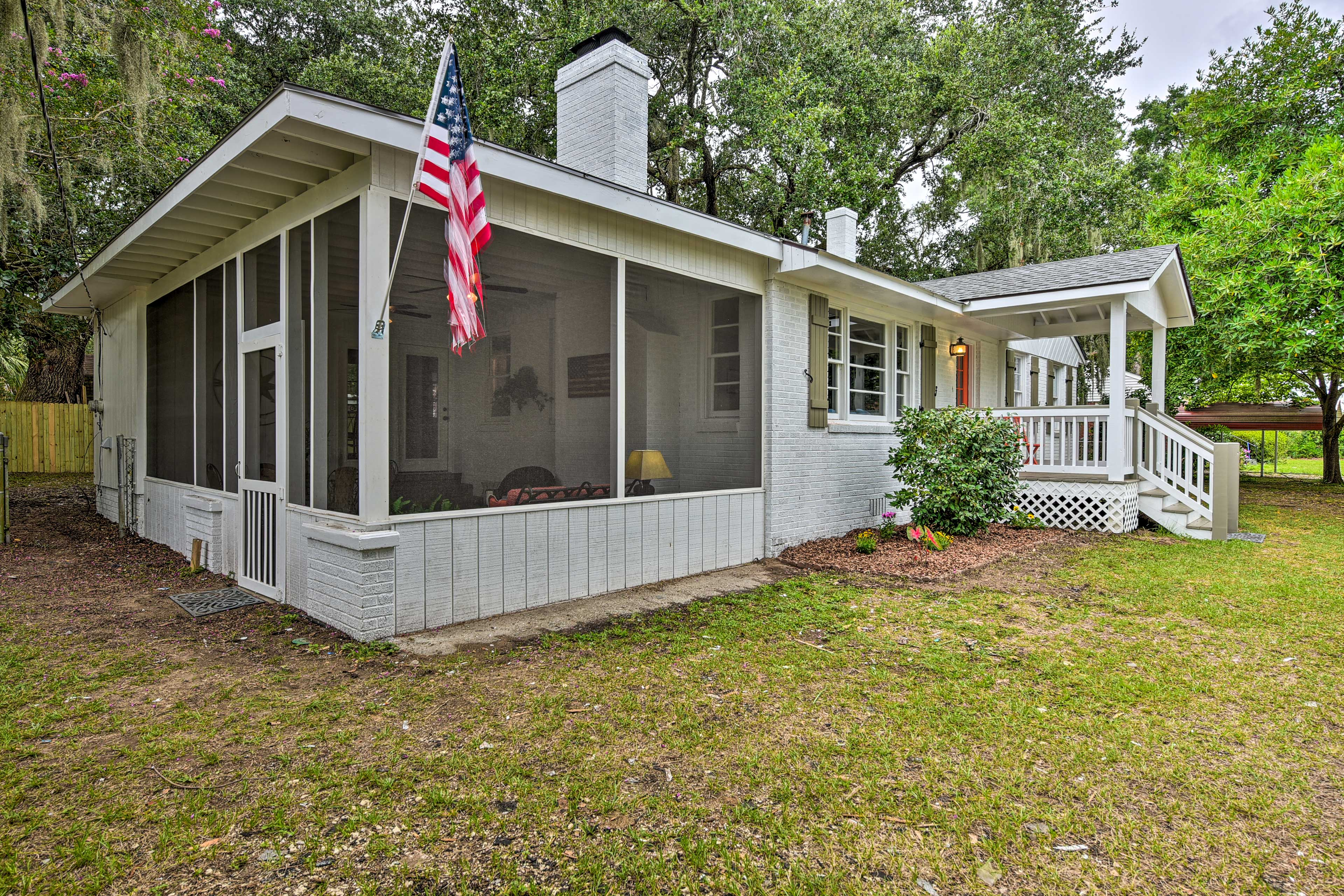 The screened-in porch can be used as a second entrance to the home.