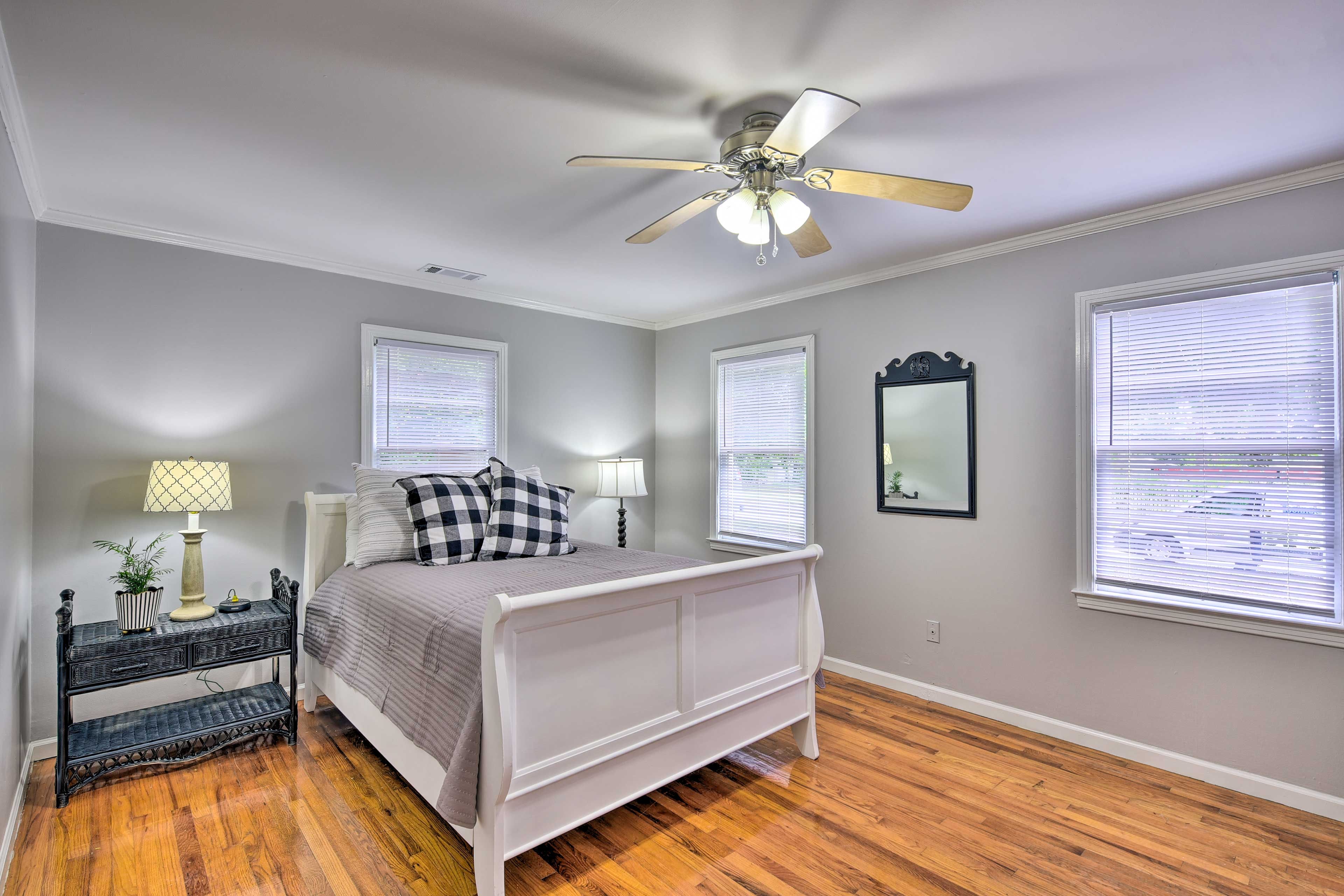 The master bedroom features a queen bed for a tired traveler.