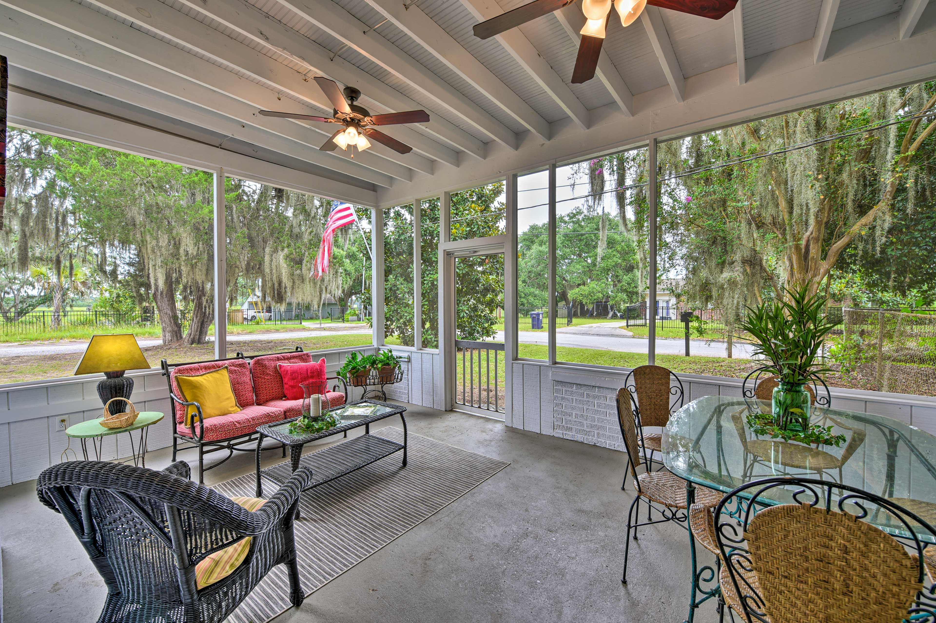 Enjoy your time outside on the screened-in porch.