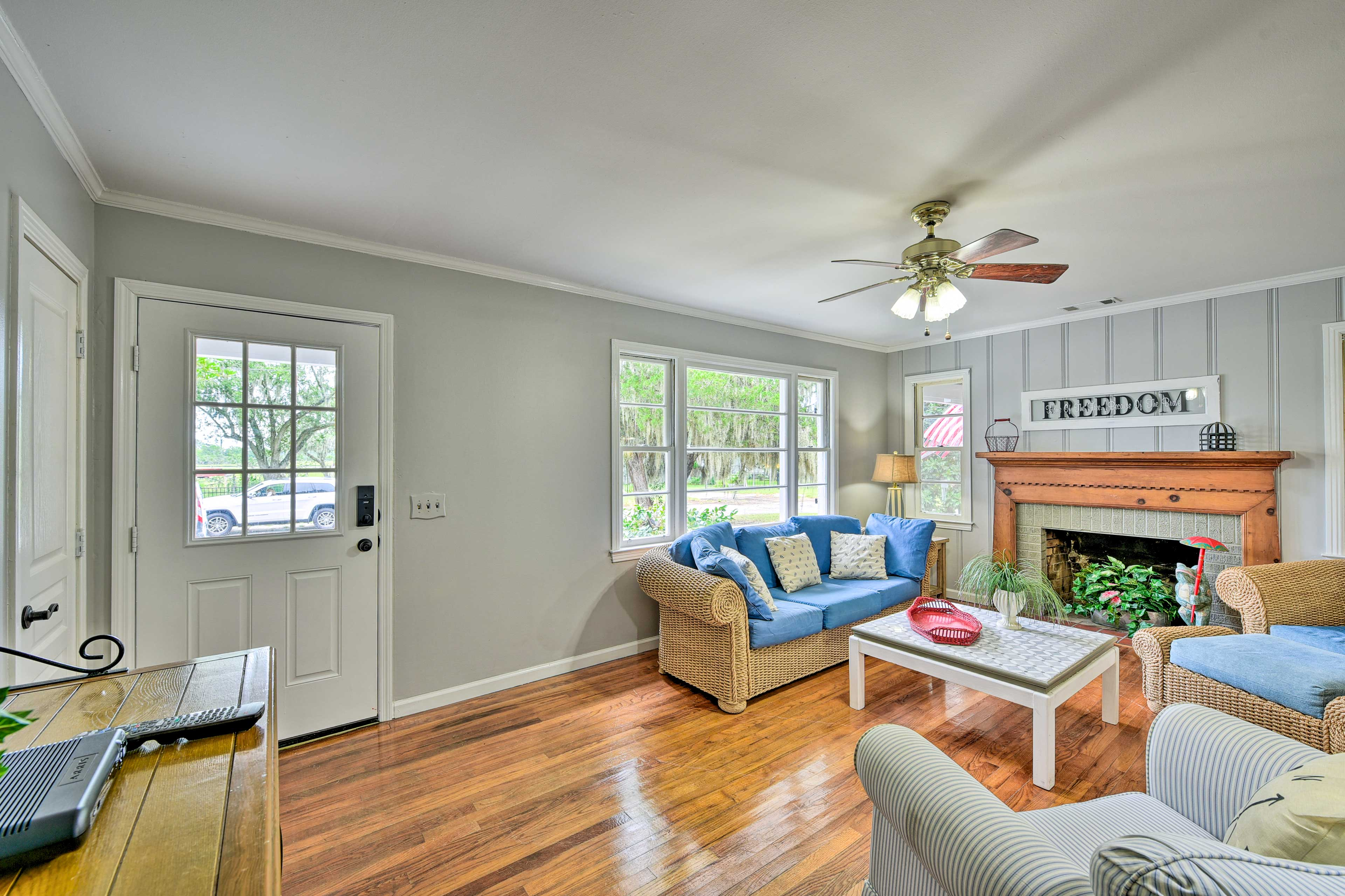 The living room boasts hardwood floors and a decorative fireplace.