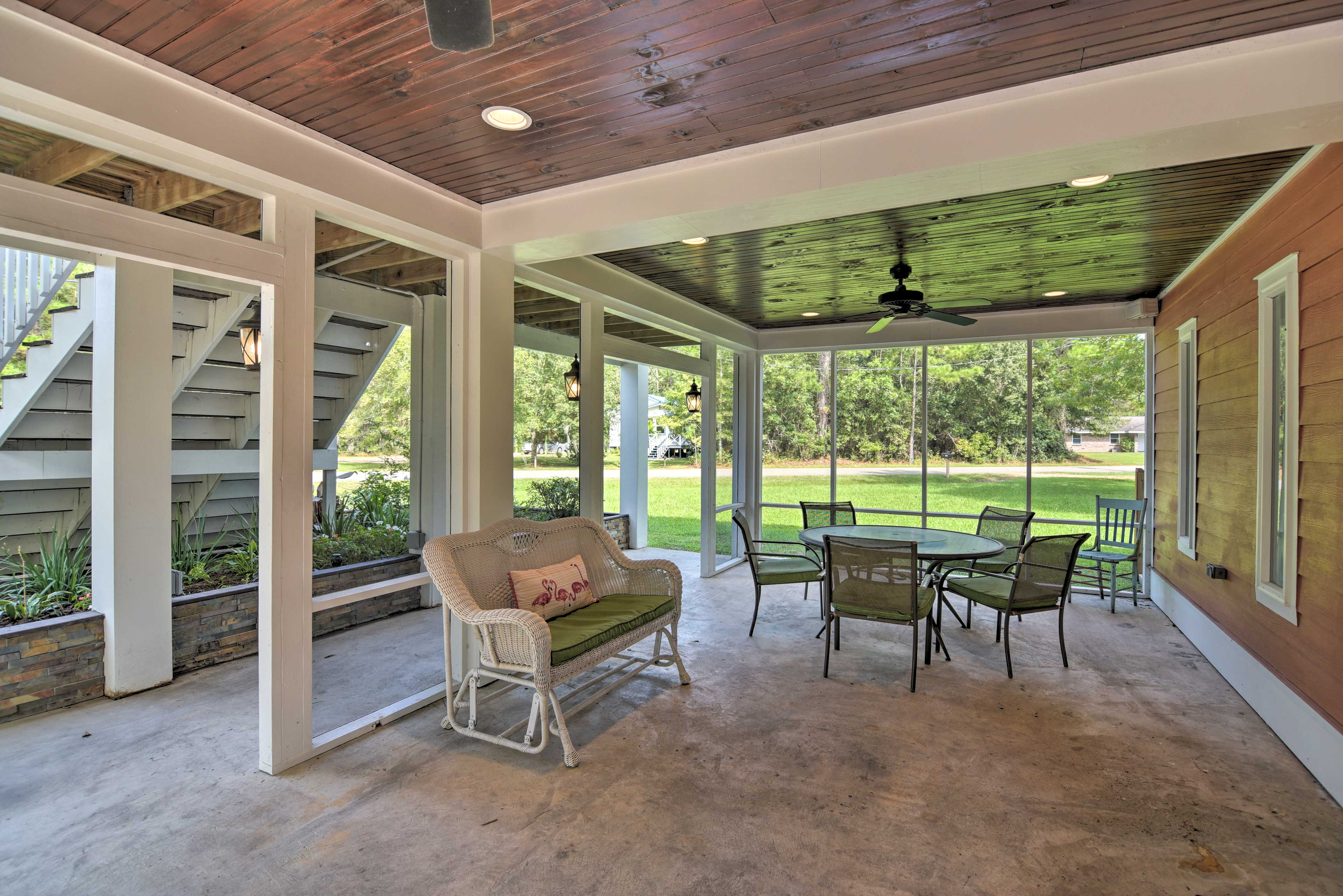 This covered front patio is now fully screened-in for bug-proofing.
