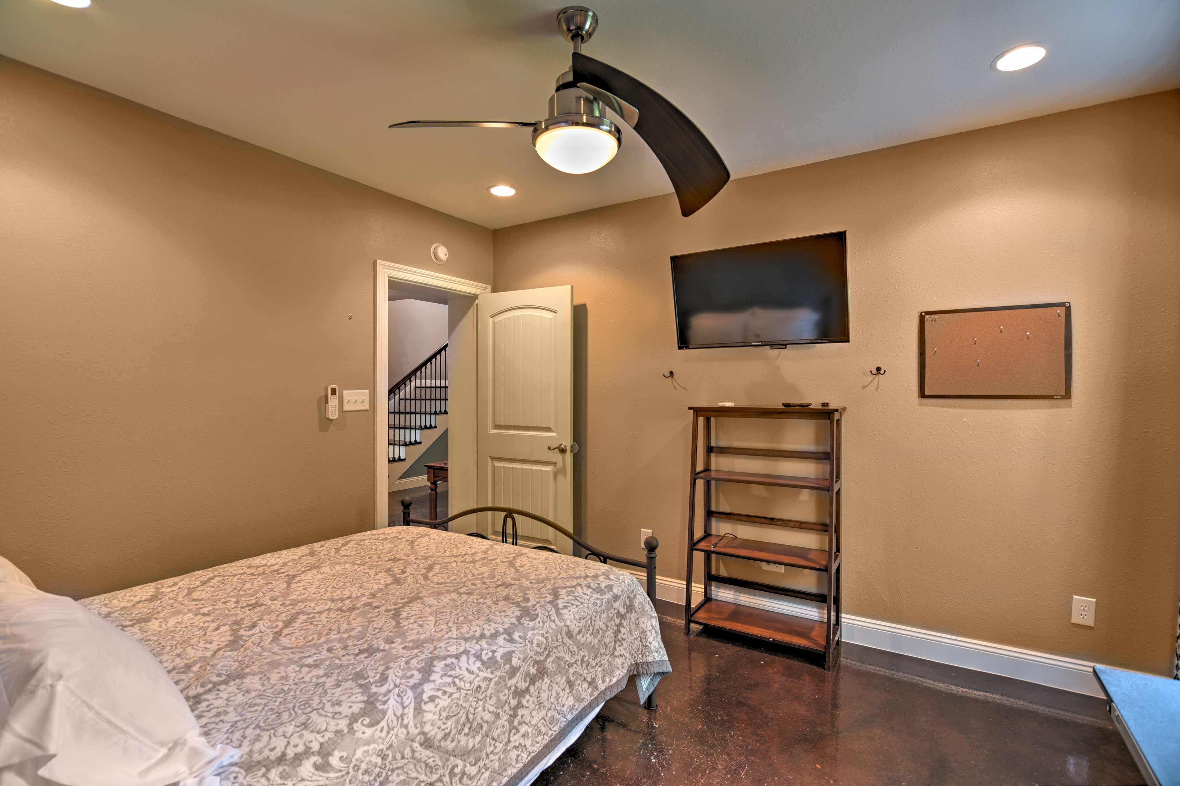 A ceiling fan and ductless mini-split AC keep you cool at night.