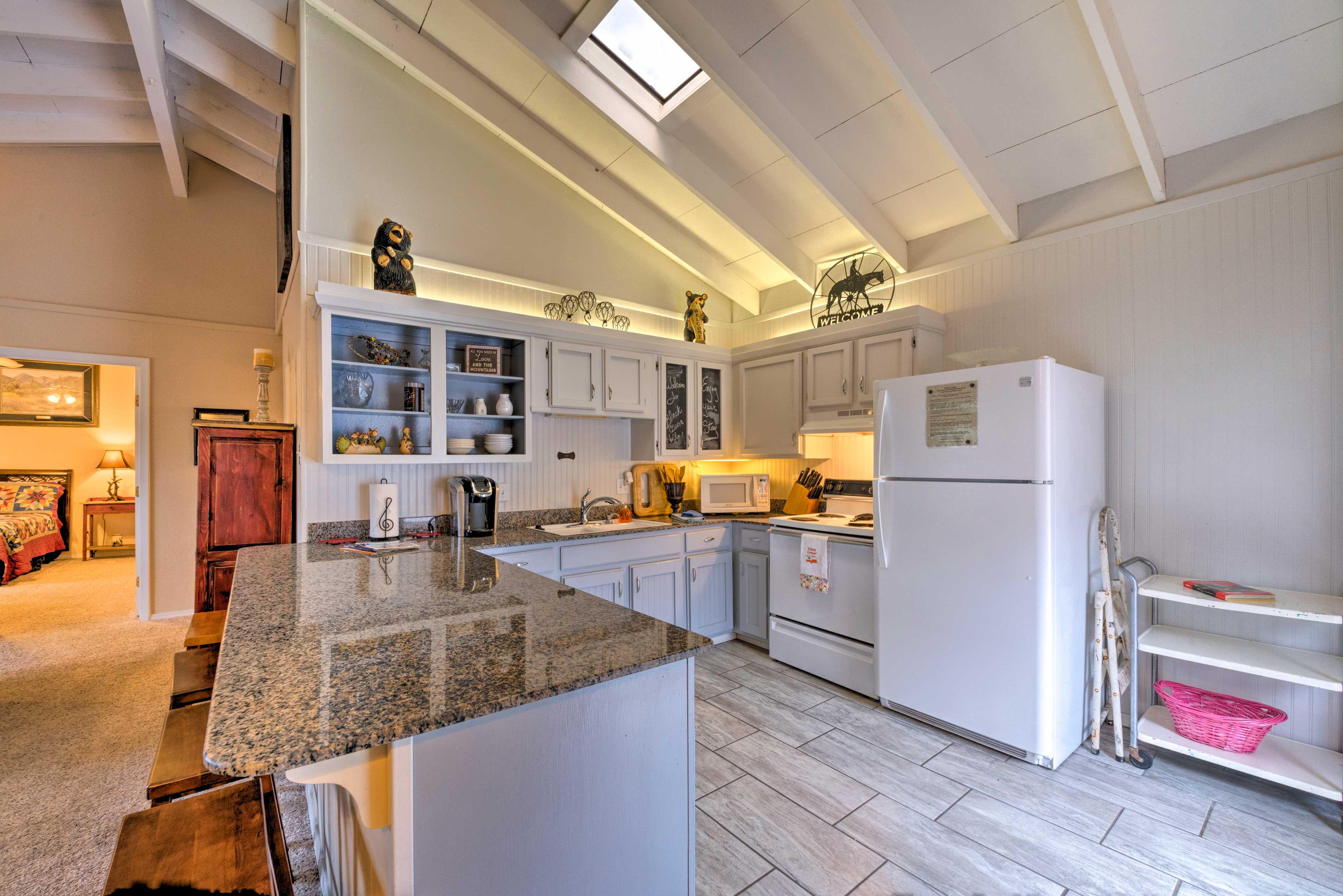 Prepare a meal on the granite countertops.