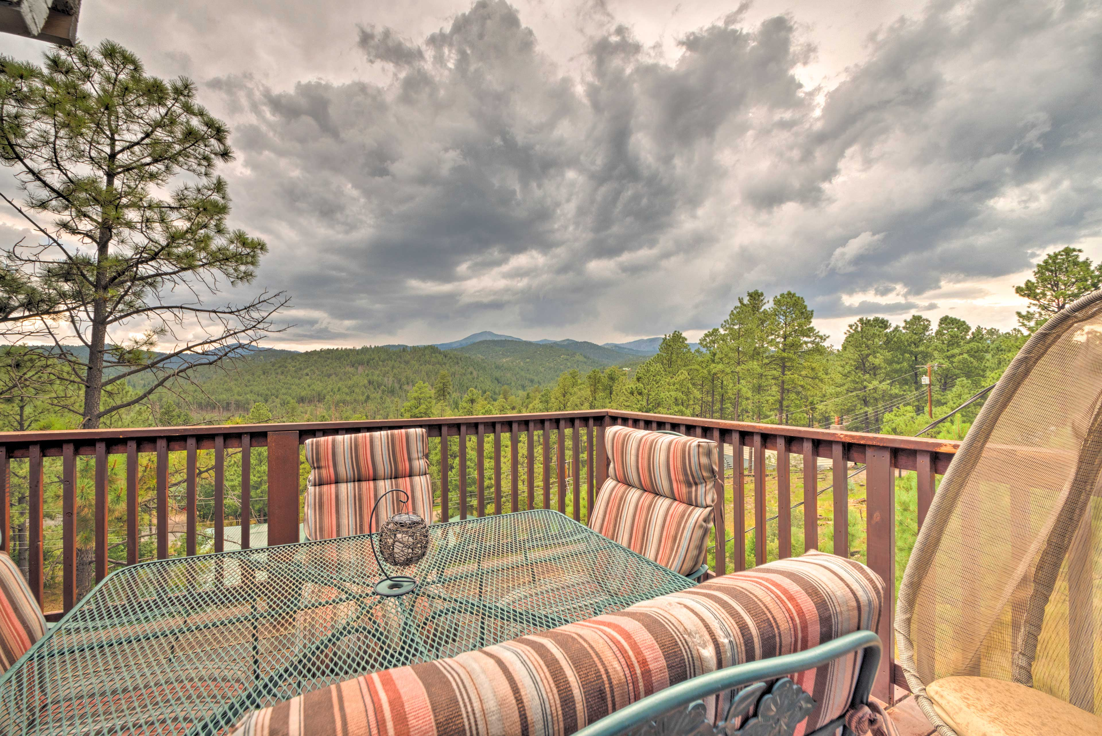 Breathe in the mountain air from the vacation rental's deck.