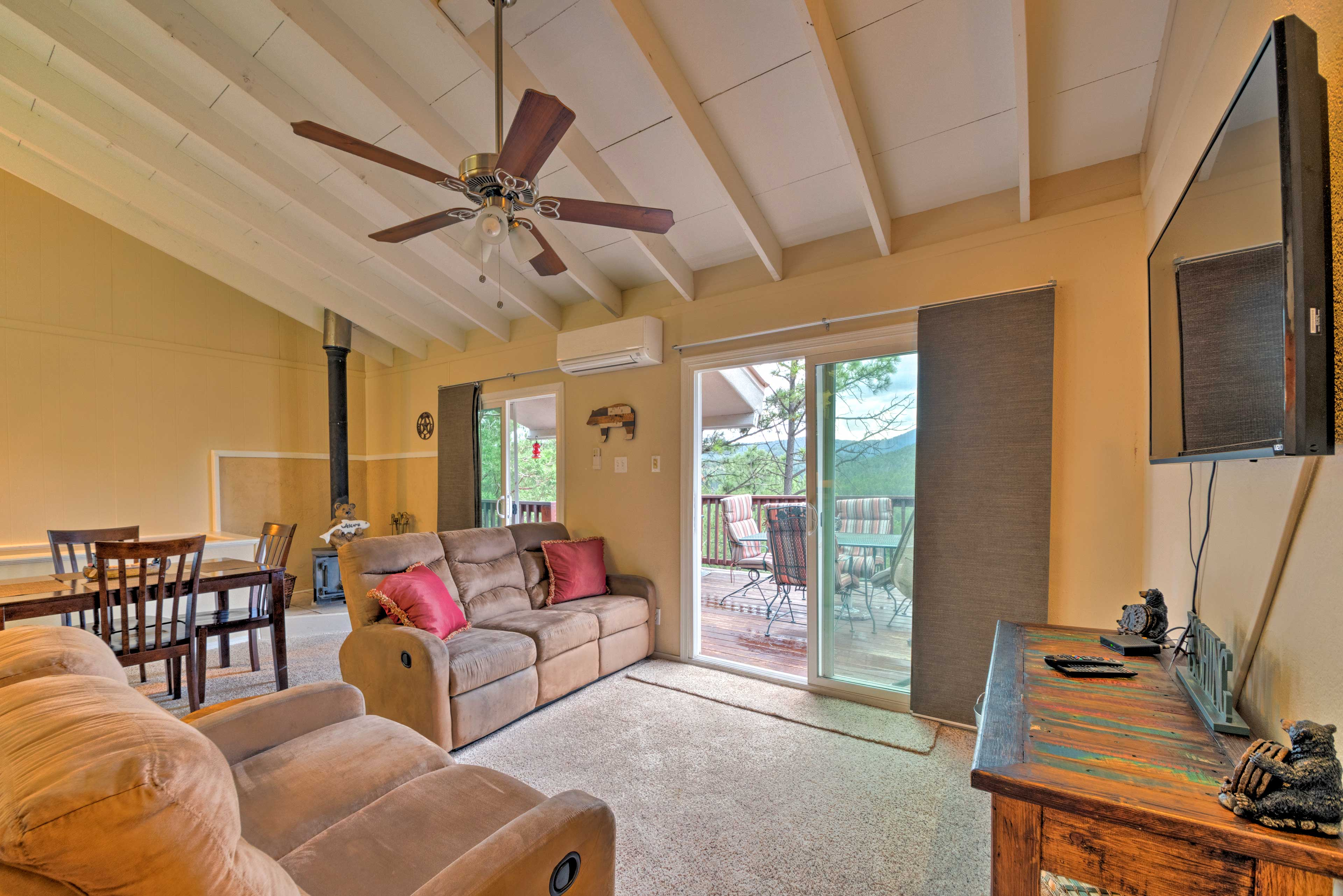 Access the deck from the sliding glass doors.