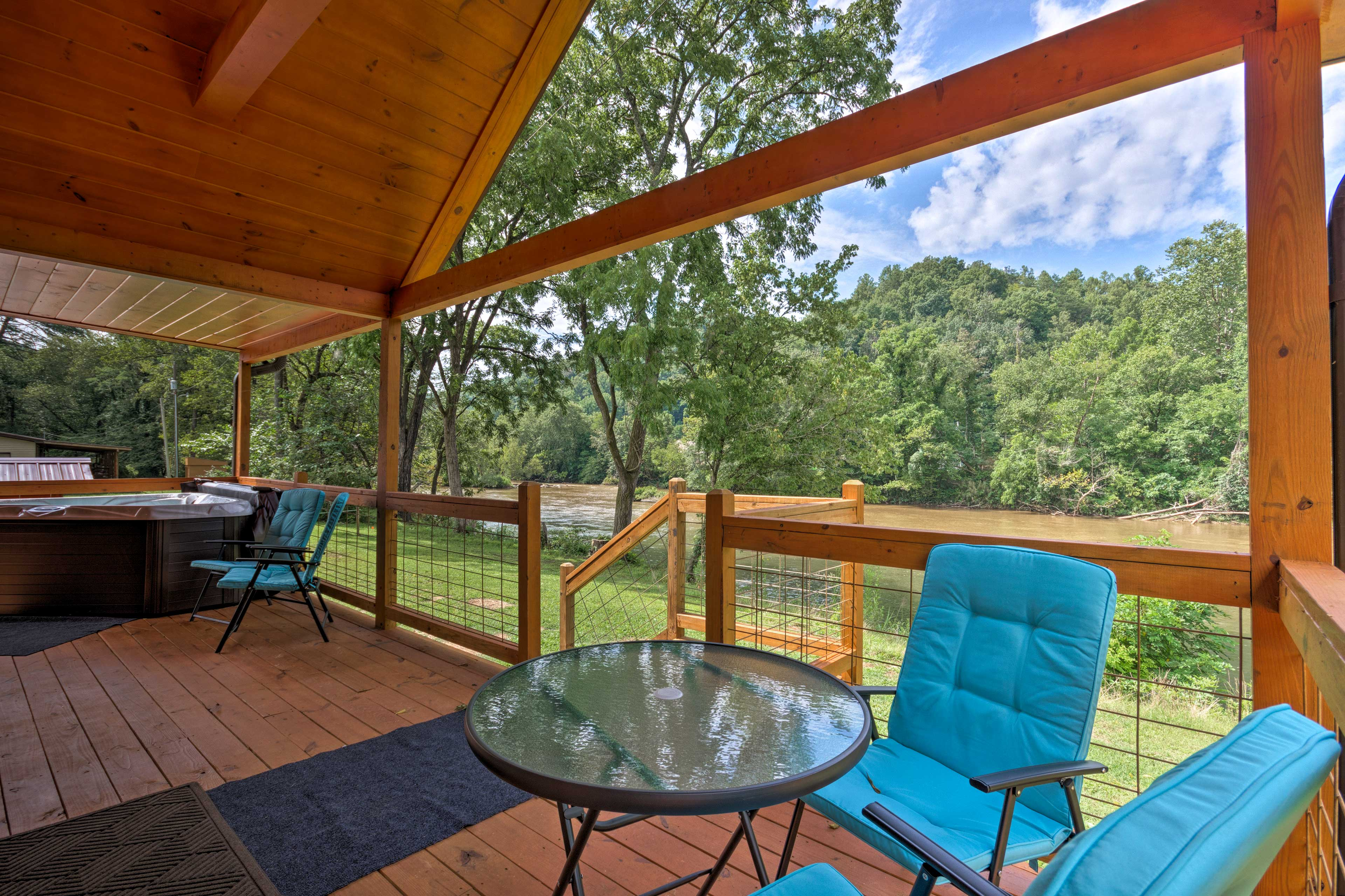 Located in Bryson City, this riverfront home is minutes from hiking and fishing.