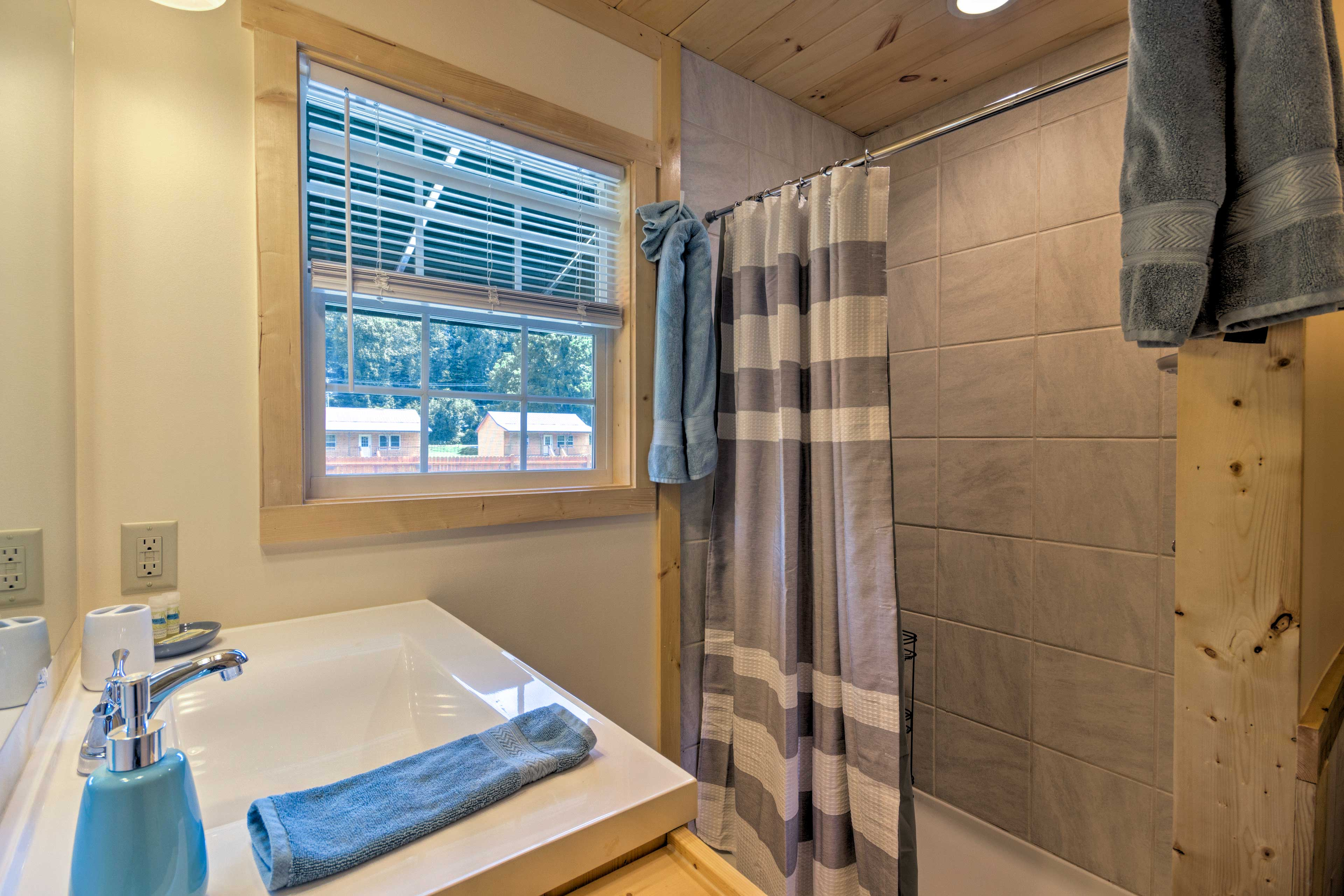 You'll find a walk-in shower in the bathroom.