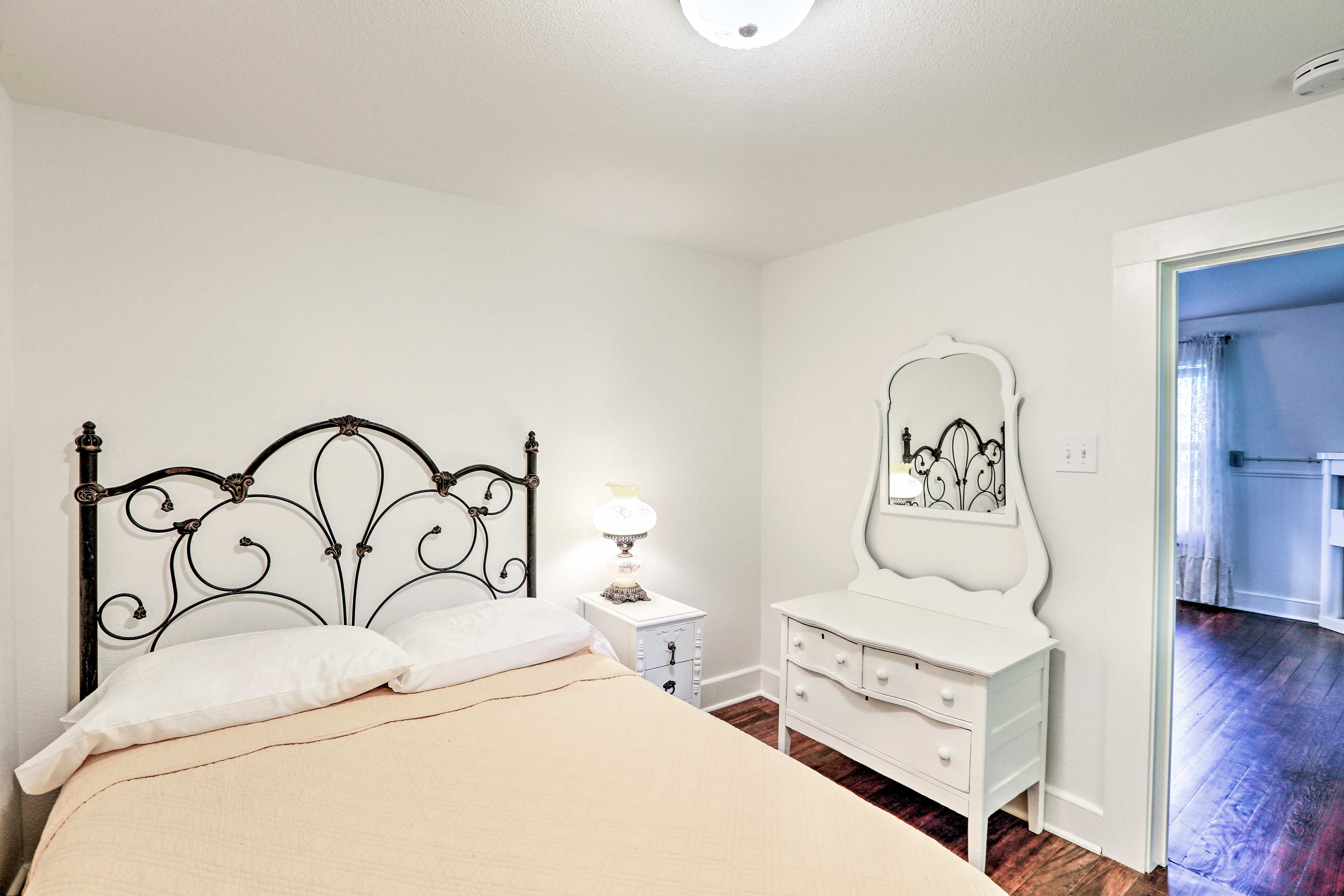 The yellow room includes a full-sized bed.