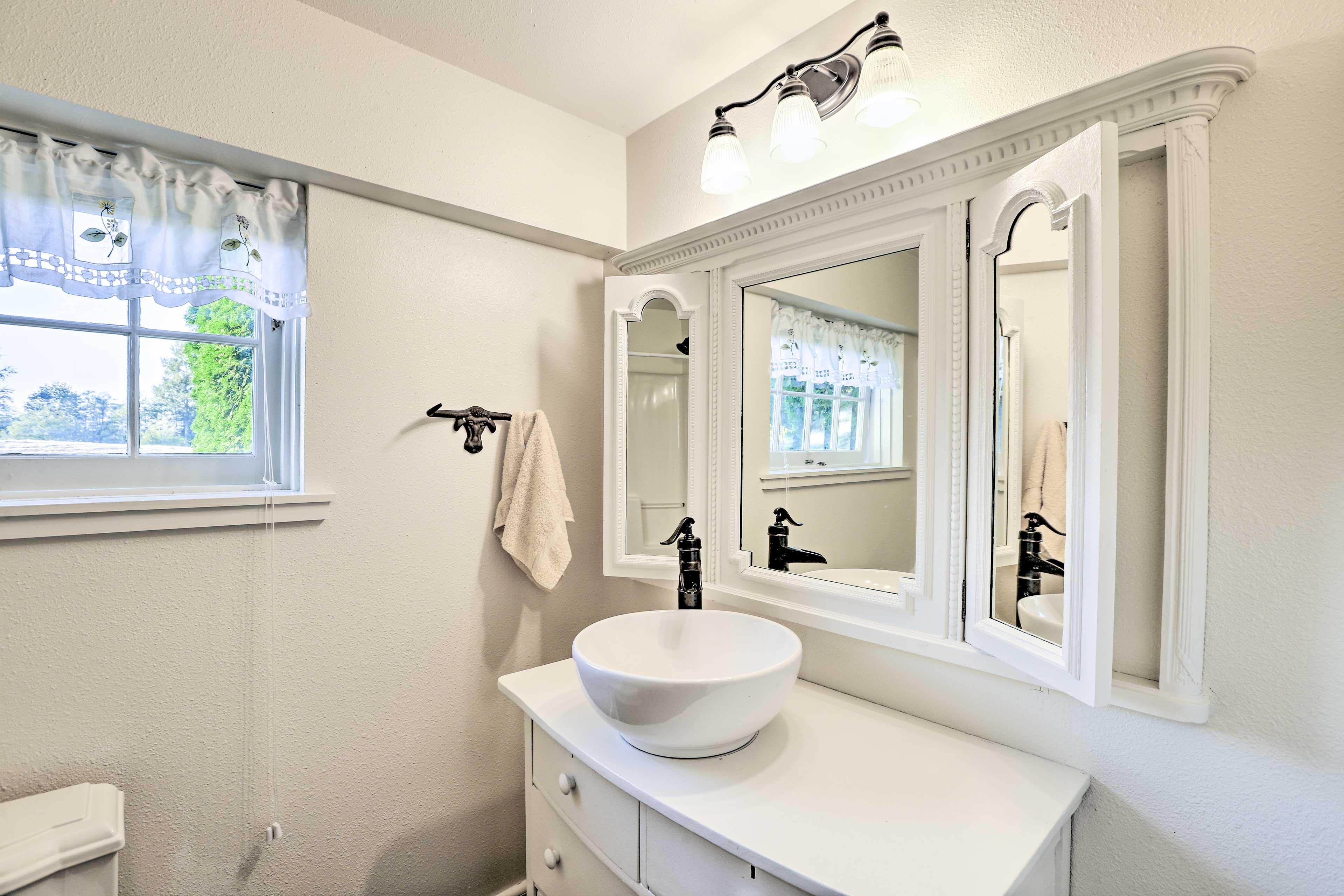 Prep for the day in the pristine full bathroom.