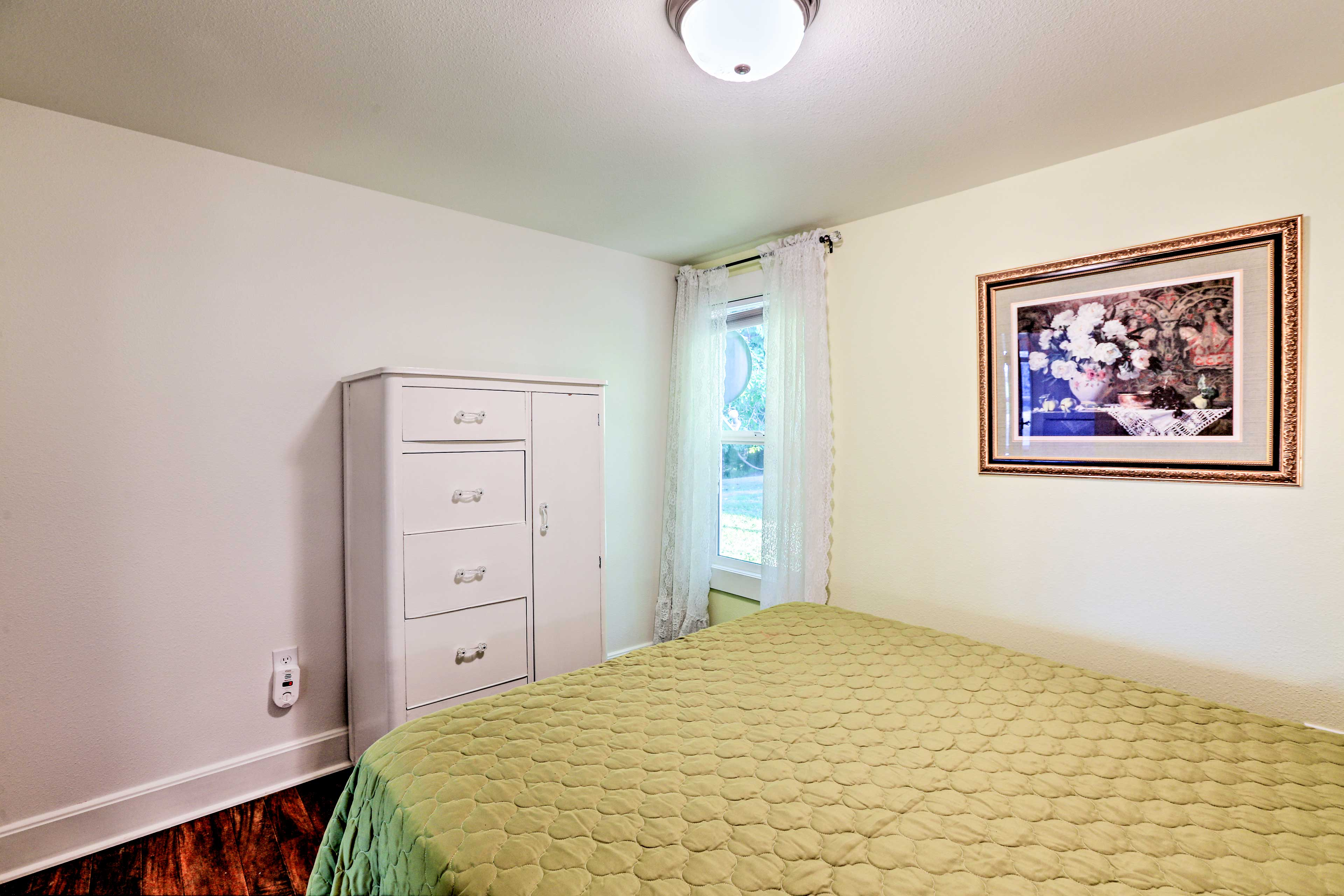 Two guests can share the queen bed in the green room.