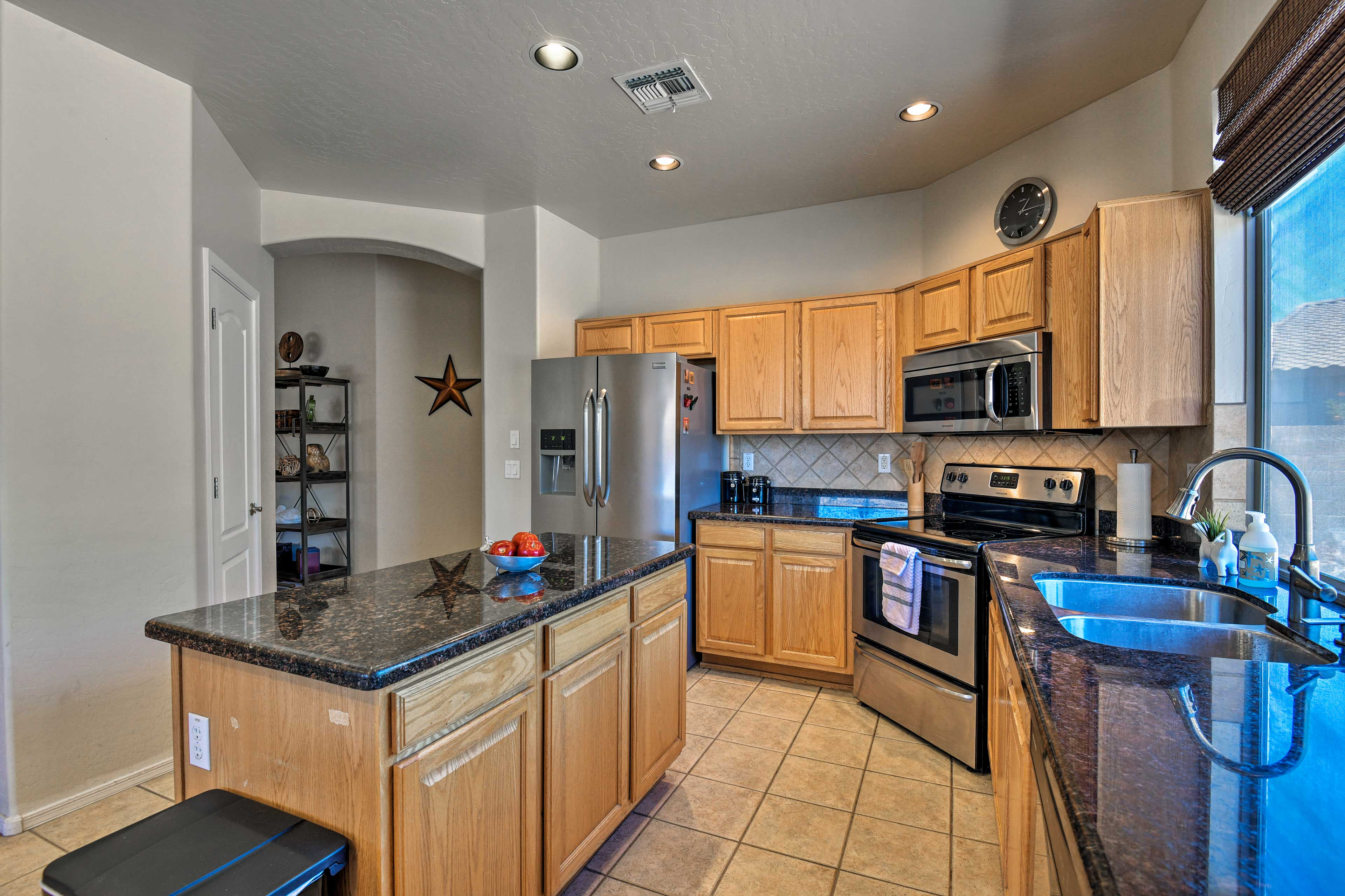The kitchen comes fully equipped for all your culinary needs.