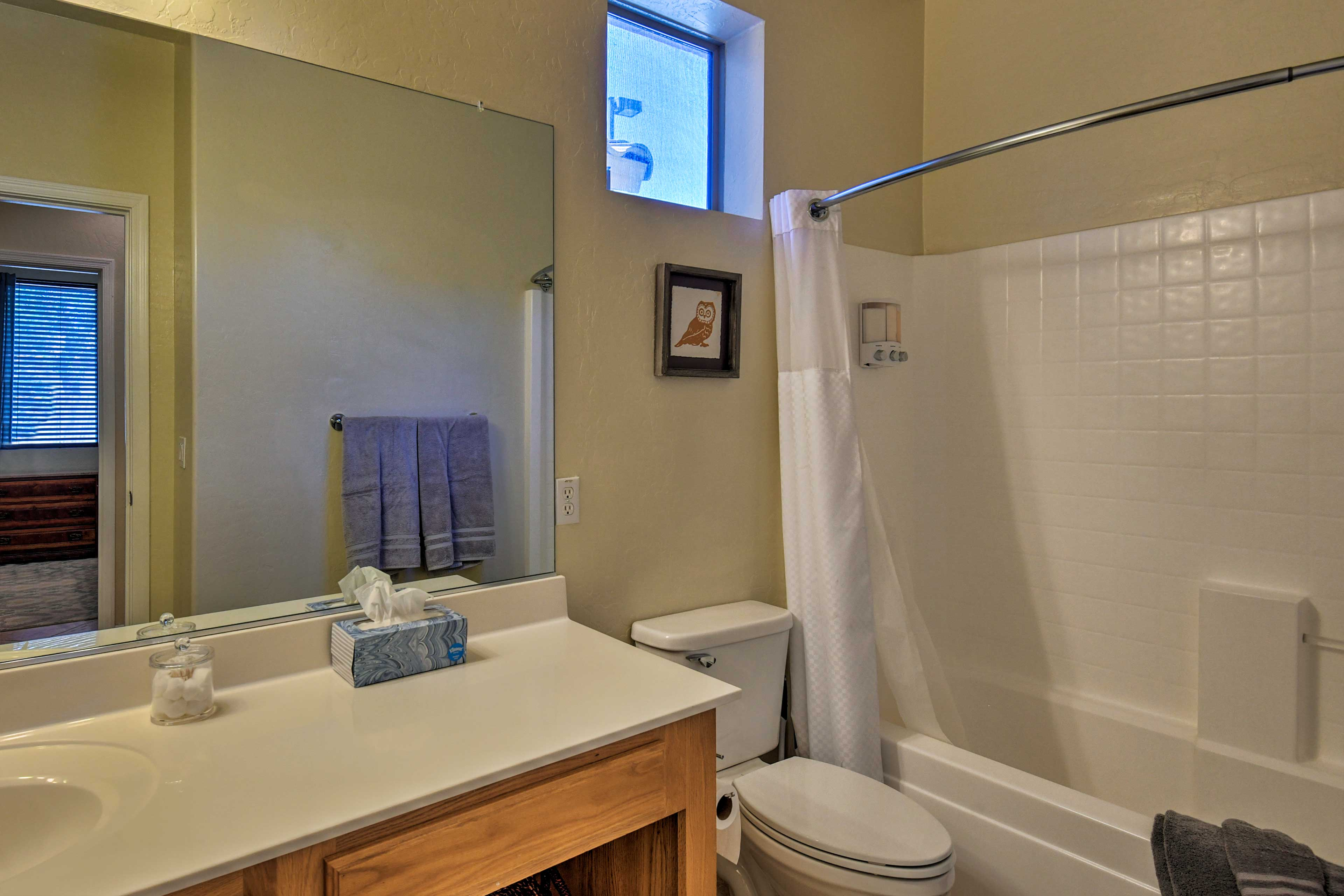 This full bathroom has a shower/tub combo.
