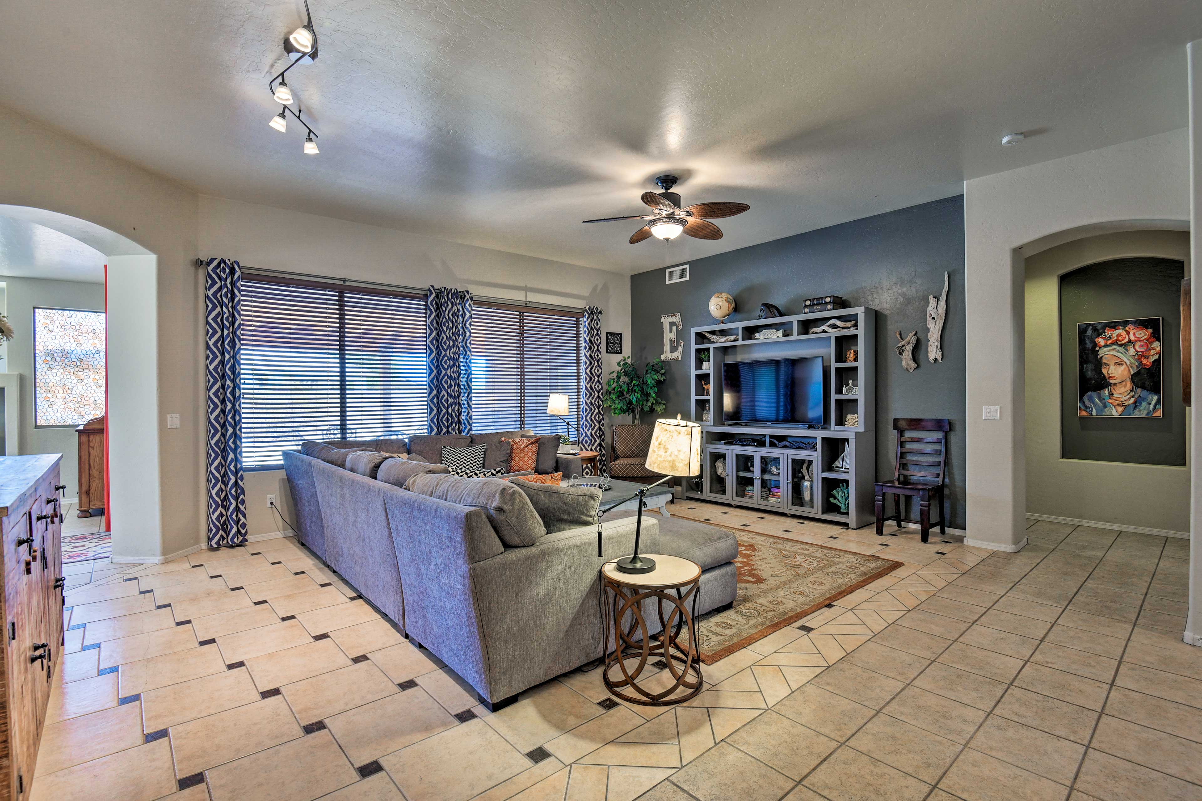 Grab a spot on the large sectional sofa and watch shows on the flat-screen TV.