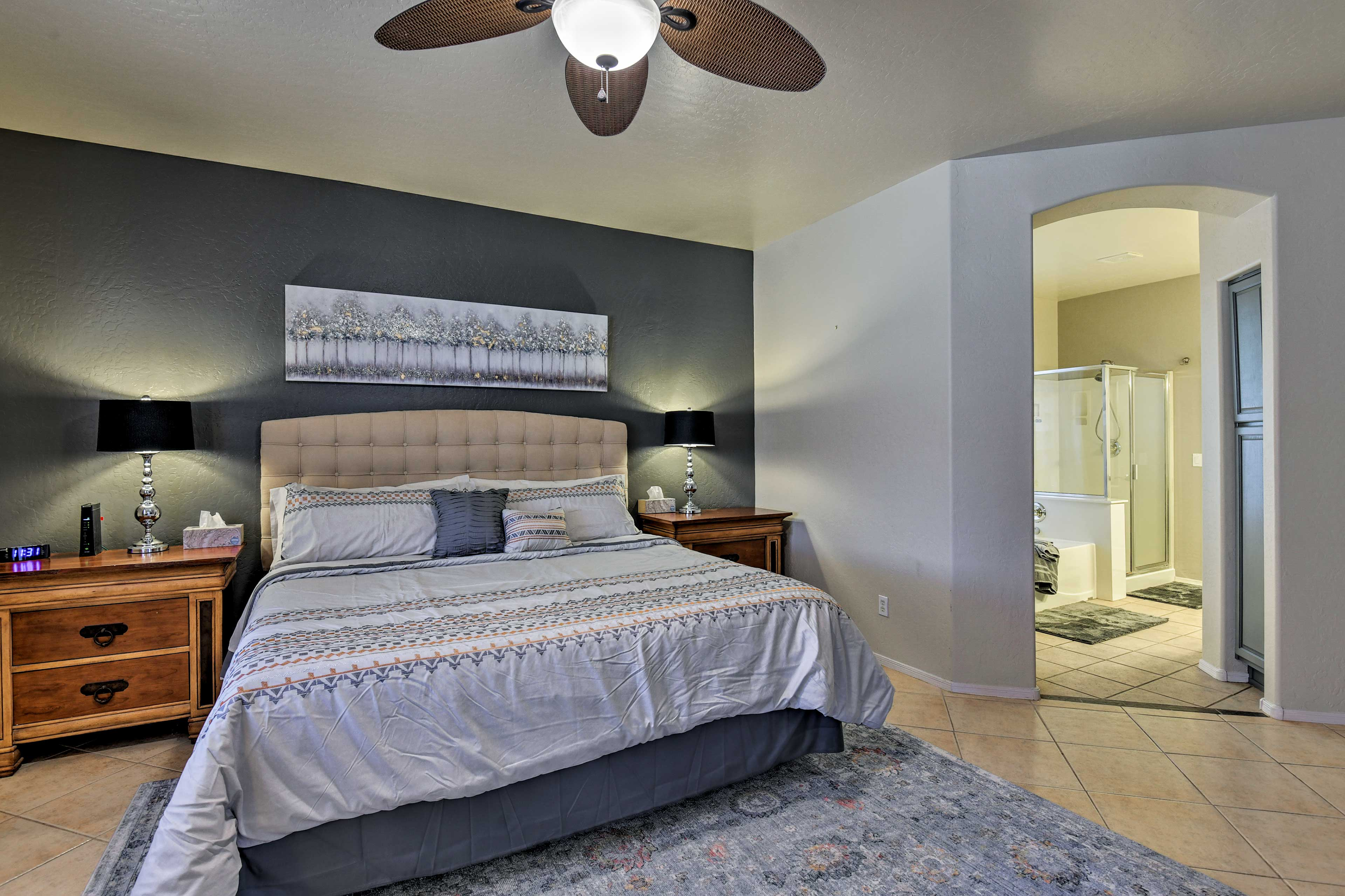 The master suite hosts a plush king-sized bed and en-suite bathroom.