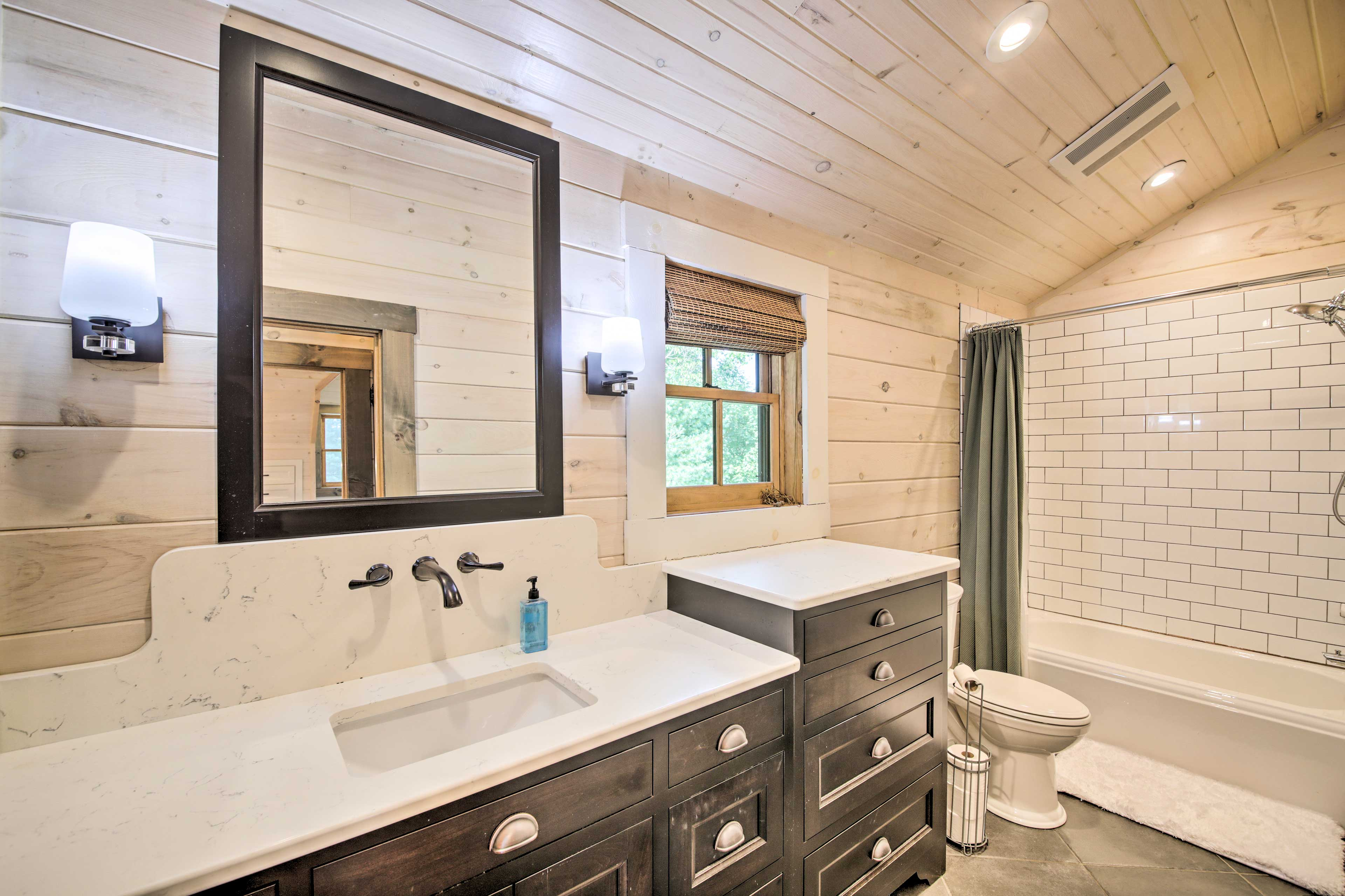 Get ready with ease in the en-suite bathroom.