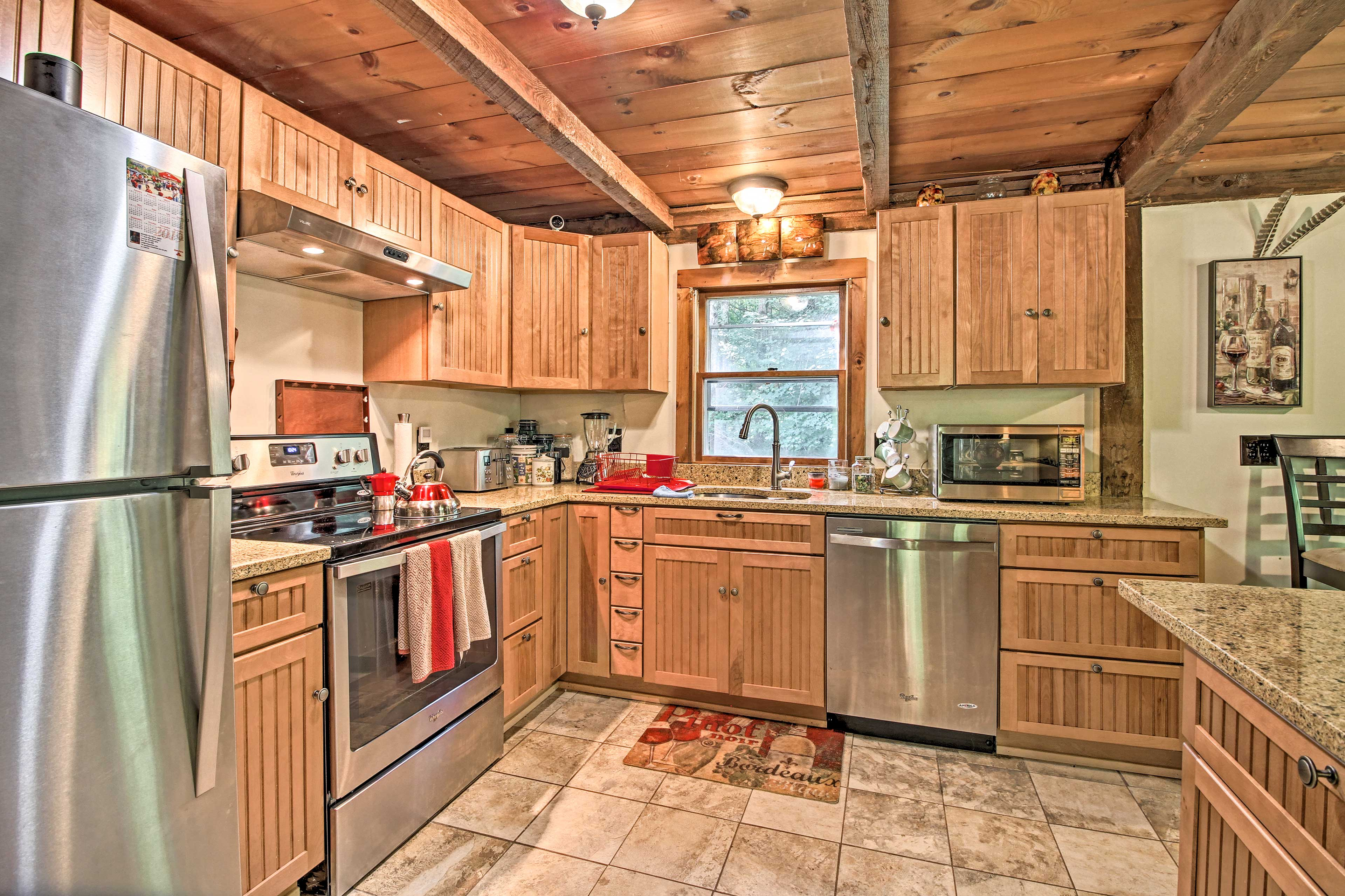 Stainless steel appliances highlight the kitchen.