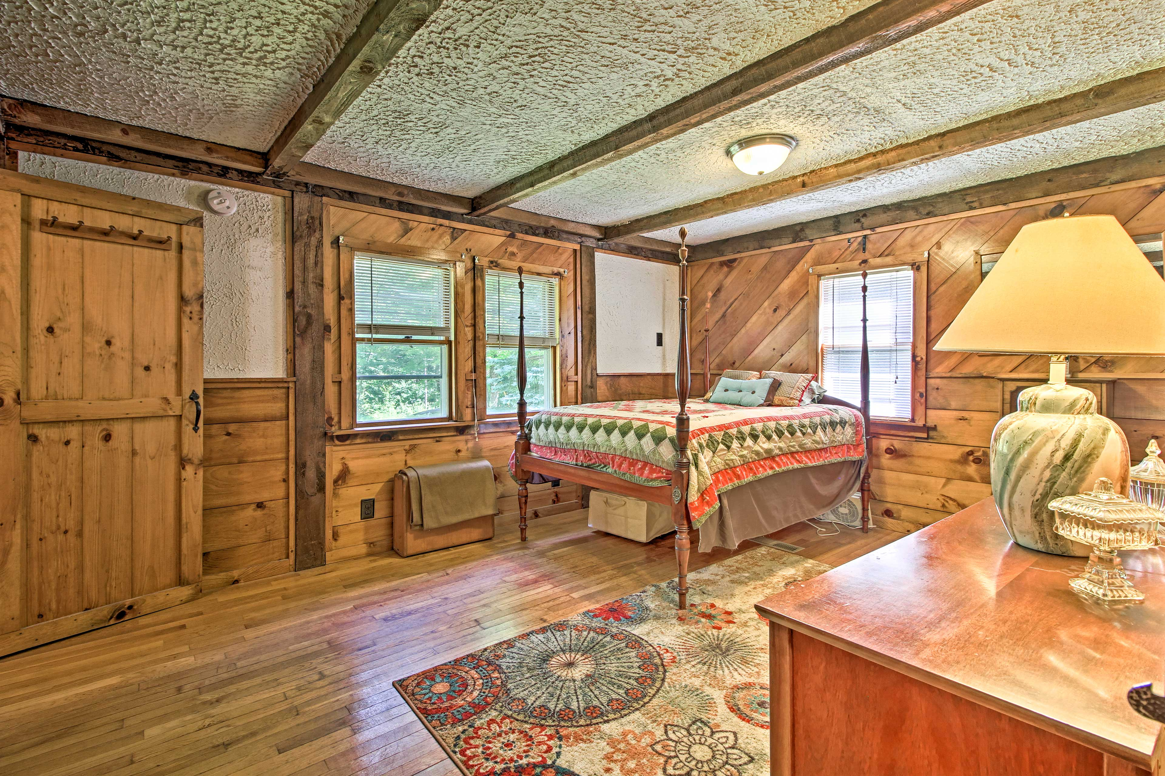 The spacious master bedroom boasts an antique queen bed.