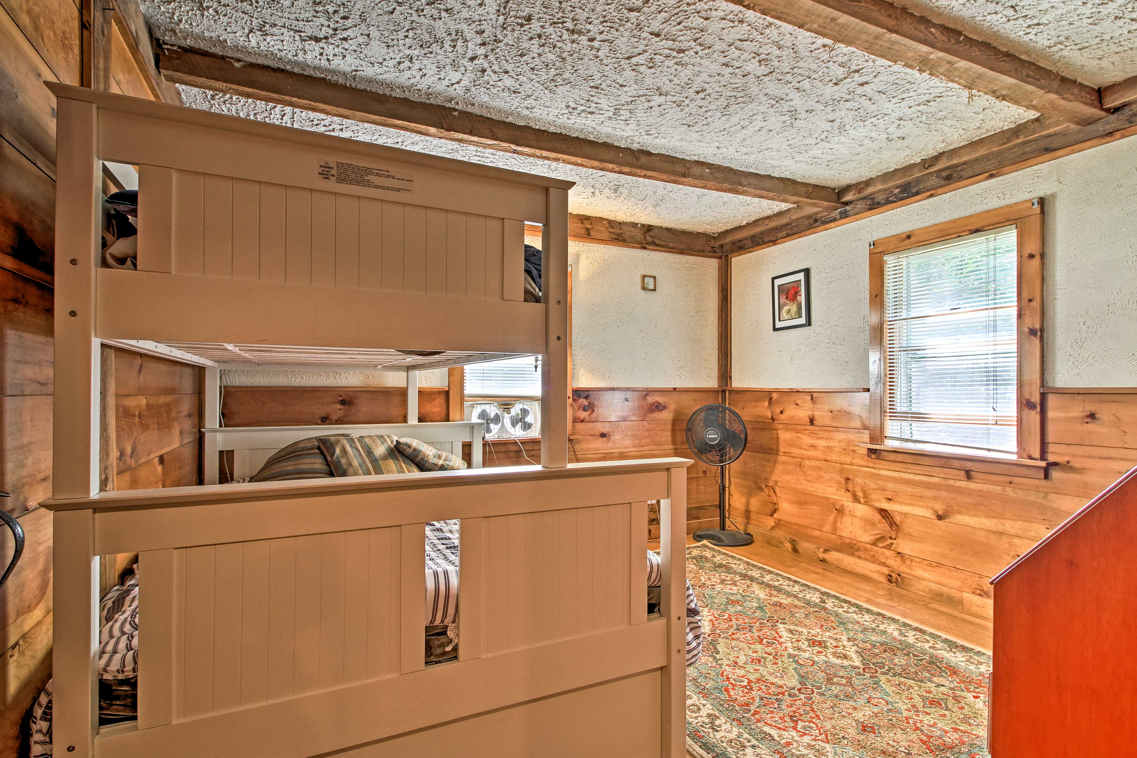The second bedroom offers a twin-over-full bunk bed.