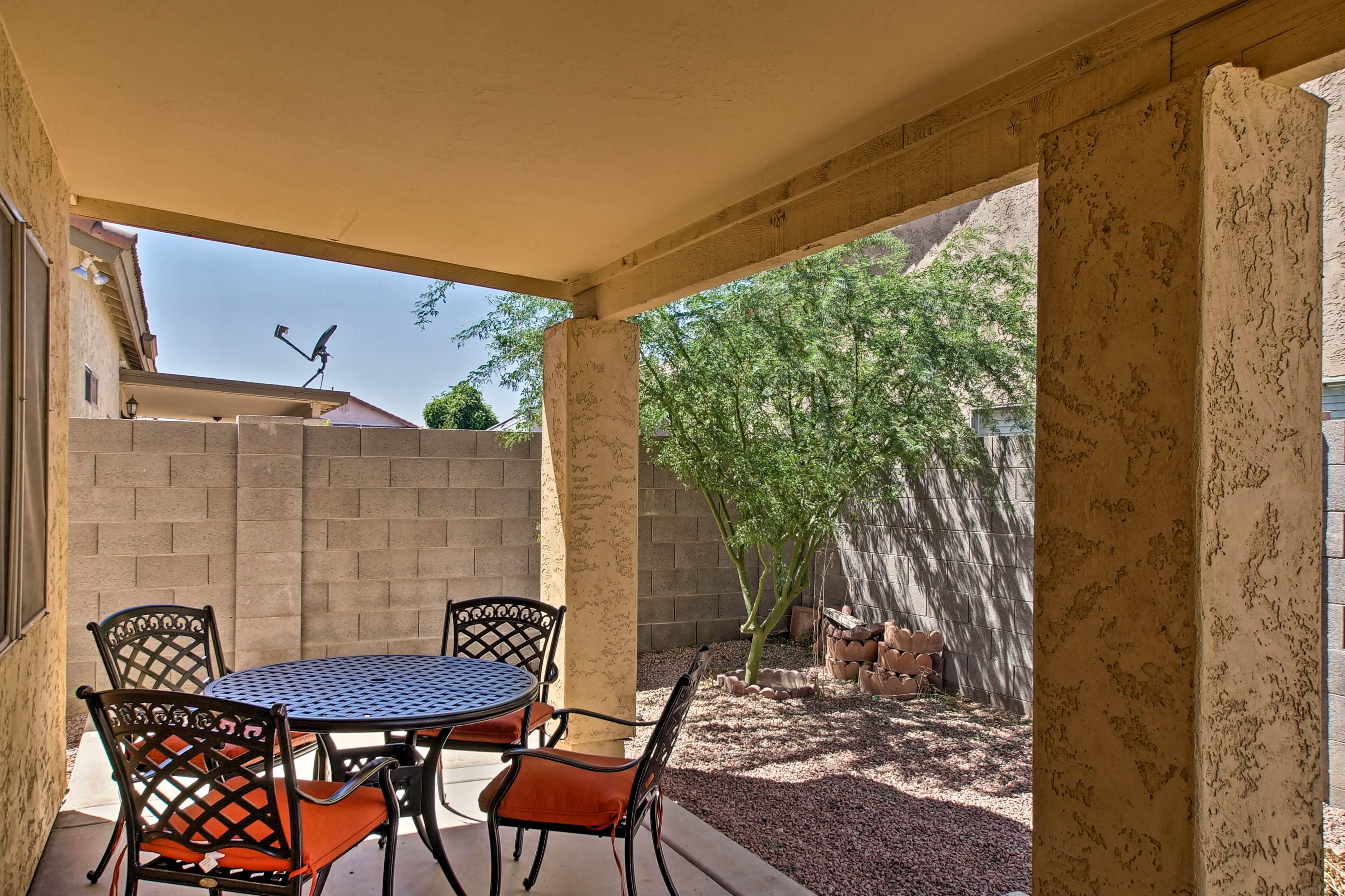 Enjoy dining al fresco on the covered back patio!