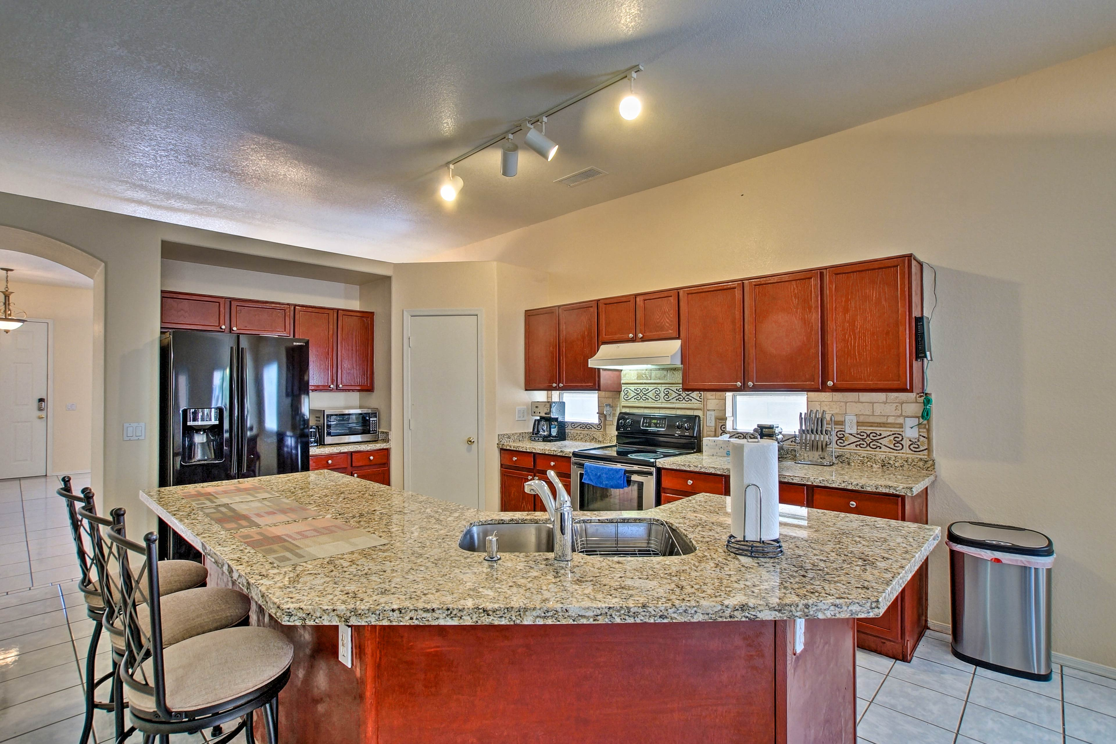 The kitchen has a 3-person breakfast bar and granite countertops.