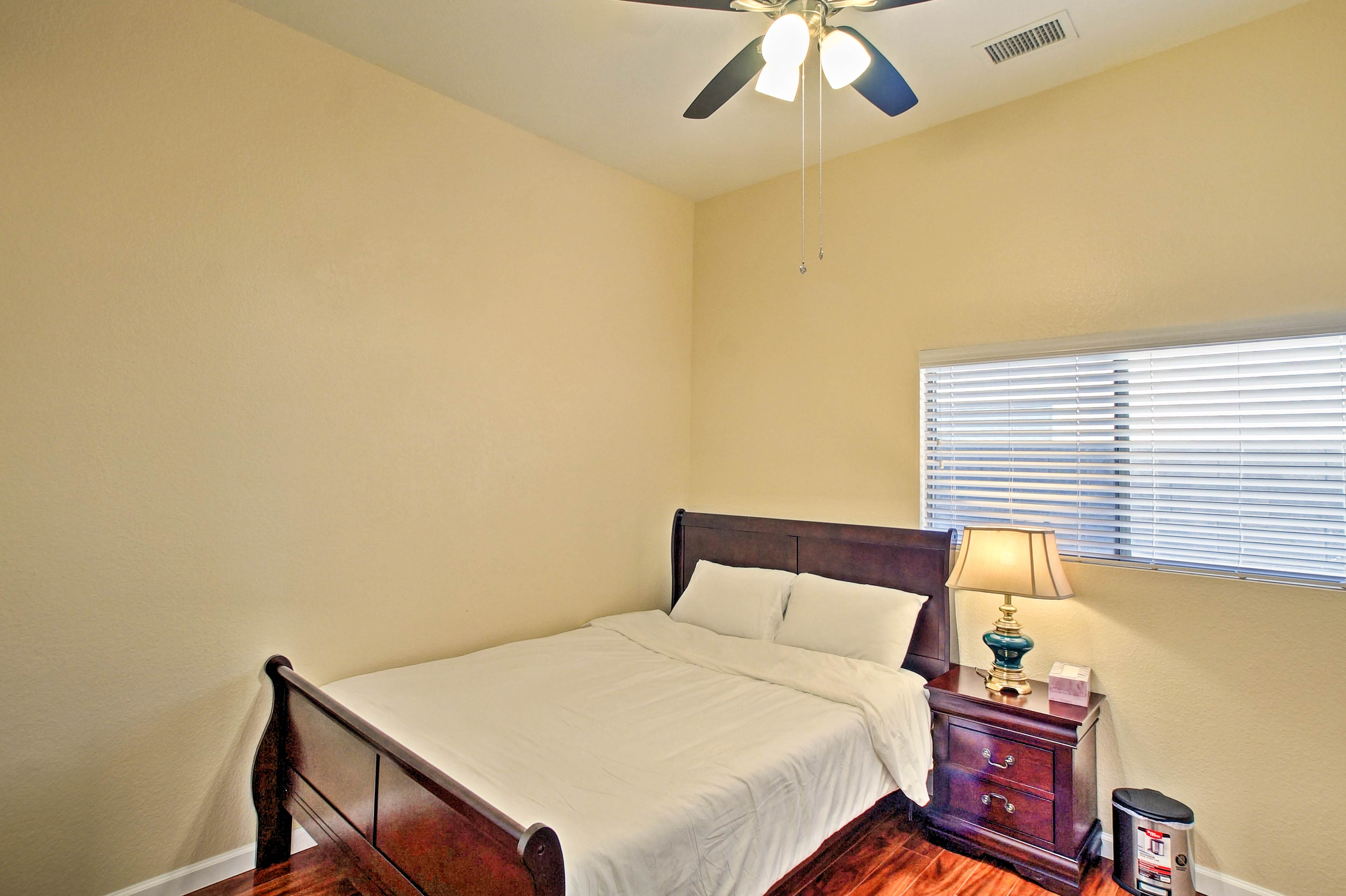 The second bedroom has a queen-sized bed.