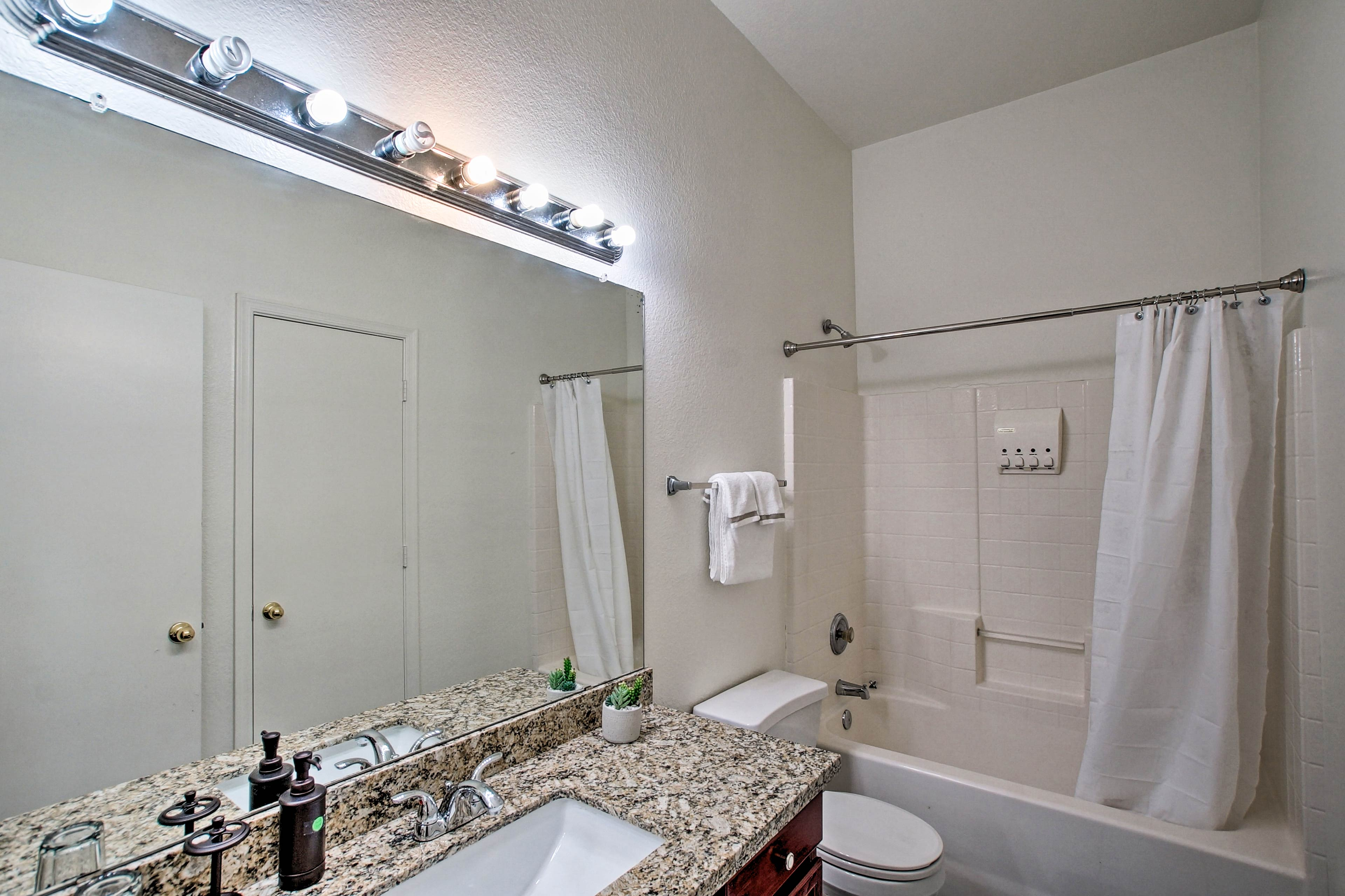 A second full bathroom offers additional privacy and complimentary toiletries.