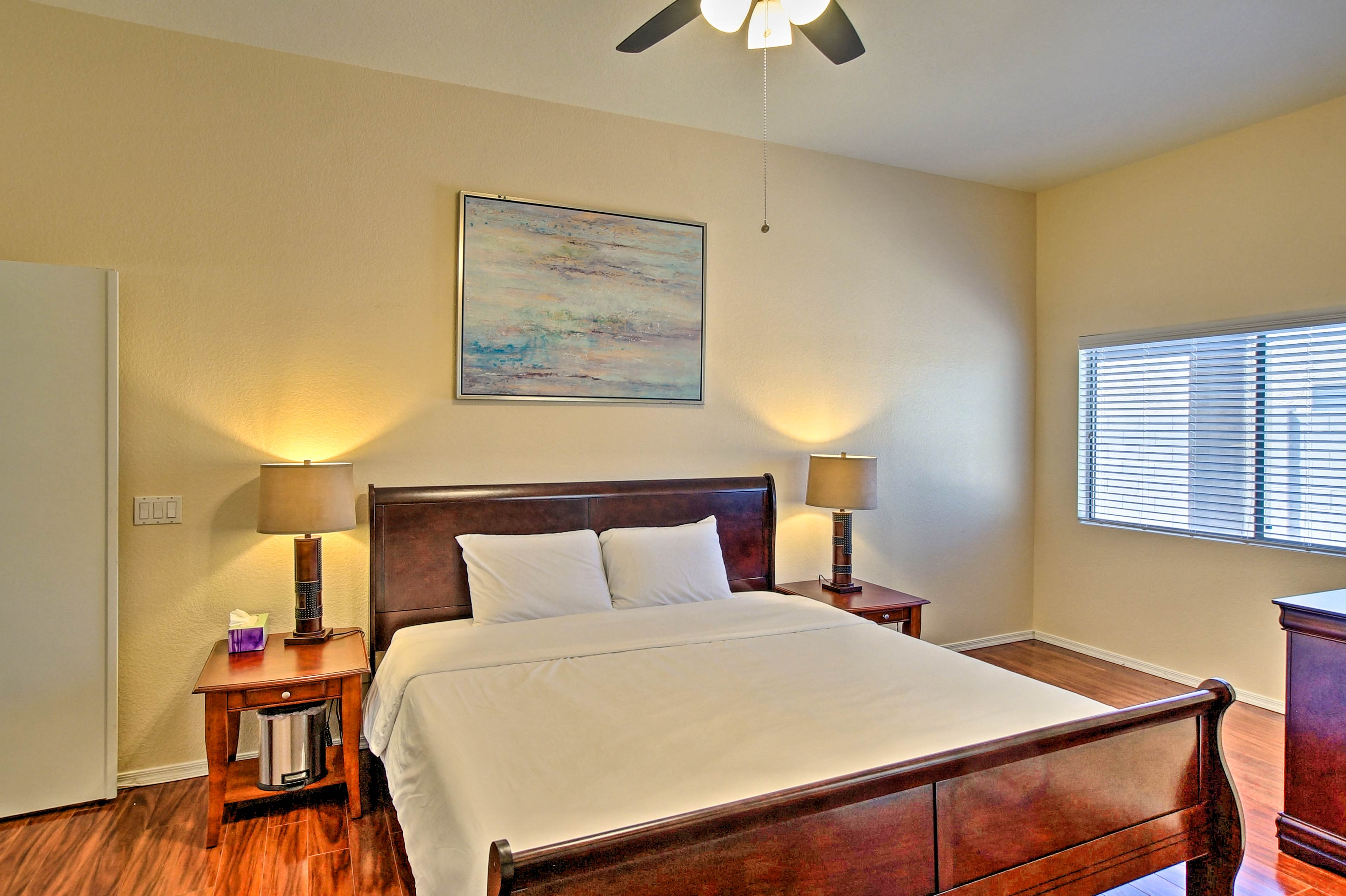 The master bedroom boasts a cozy king-sized bed.
