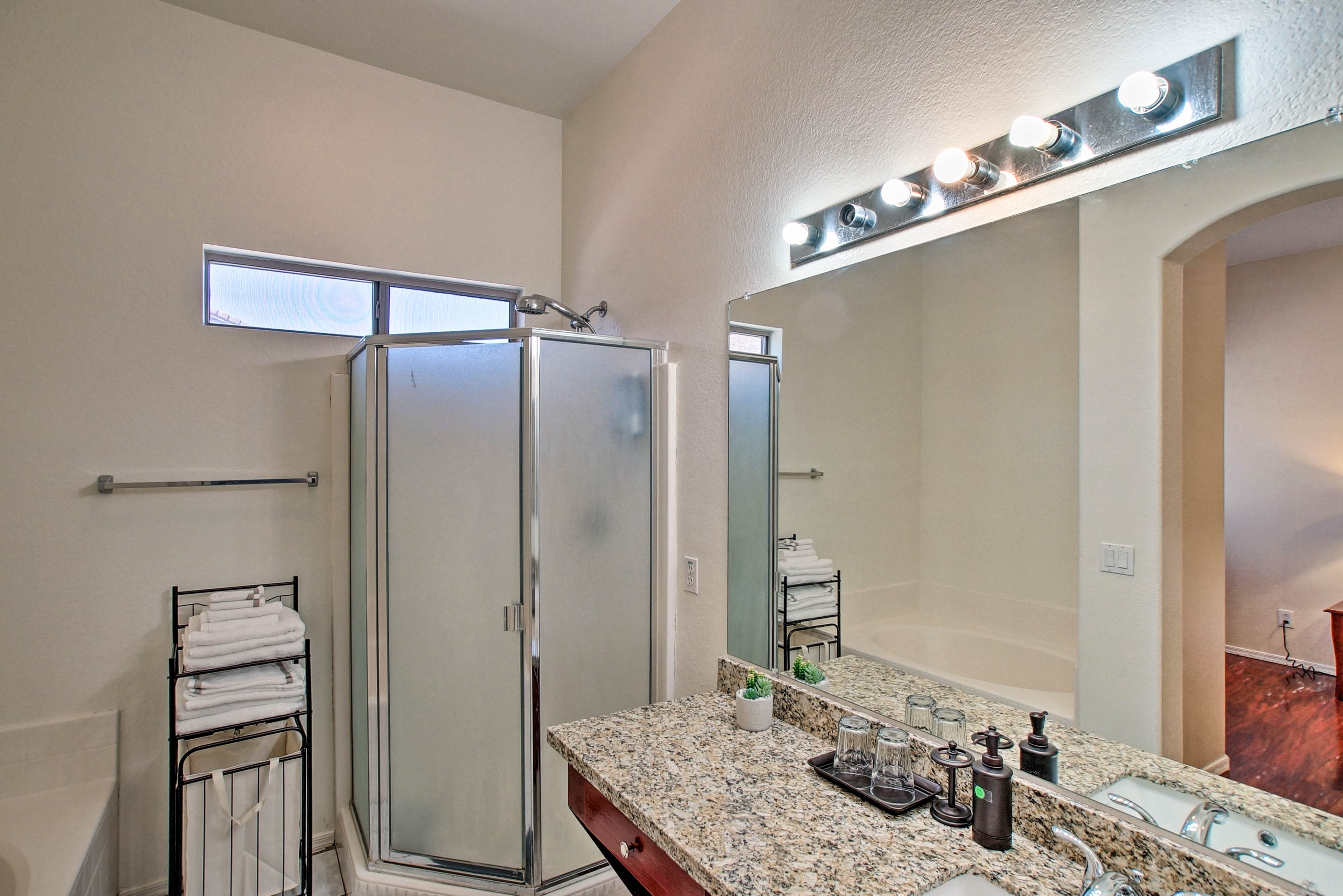The en-suite master bathroom has a stand-up shower and a soaking tub.