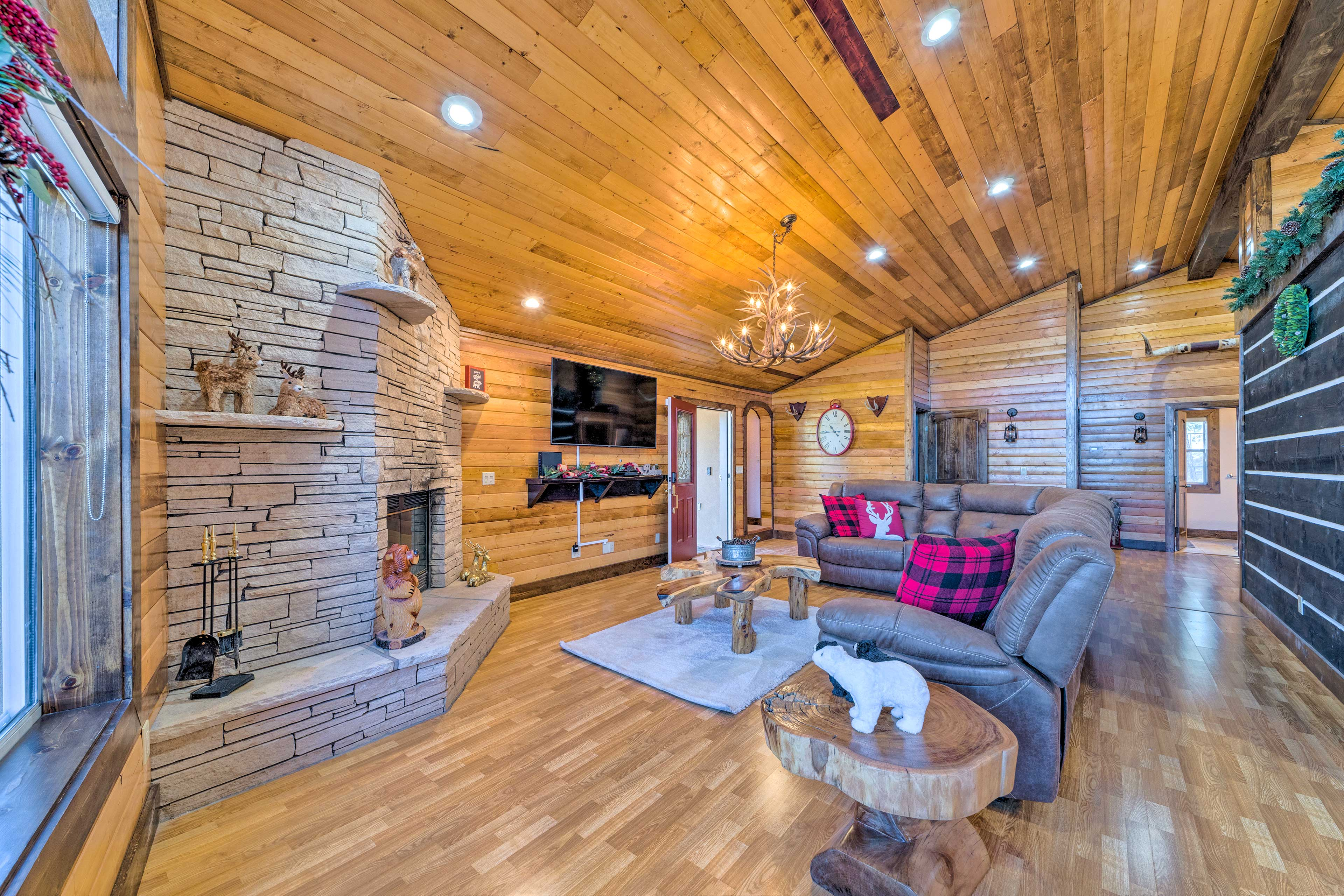 The bright and spacious interior features a large Smart TV and fireplace!