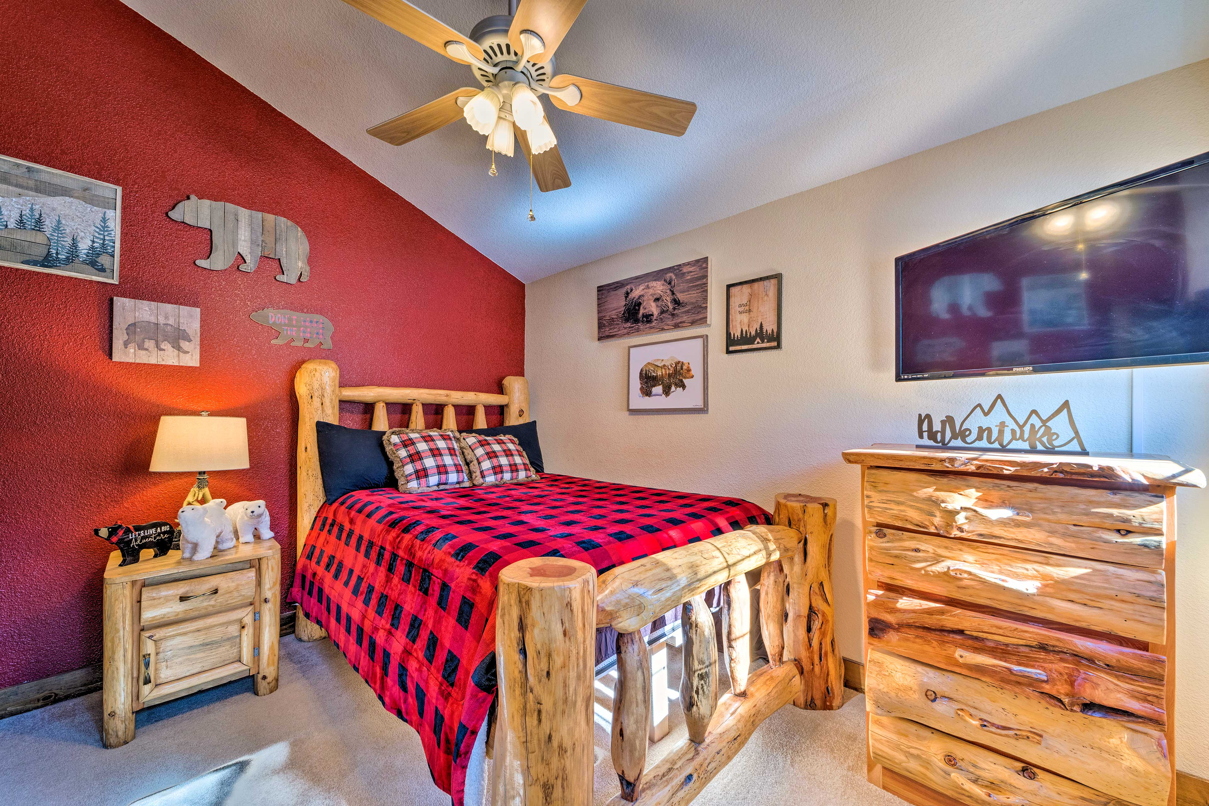 Cozy up in this queen bed each night.