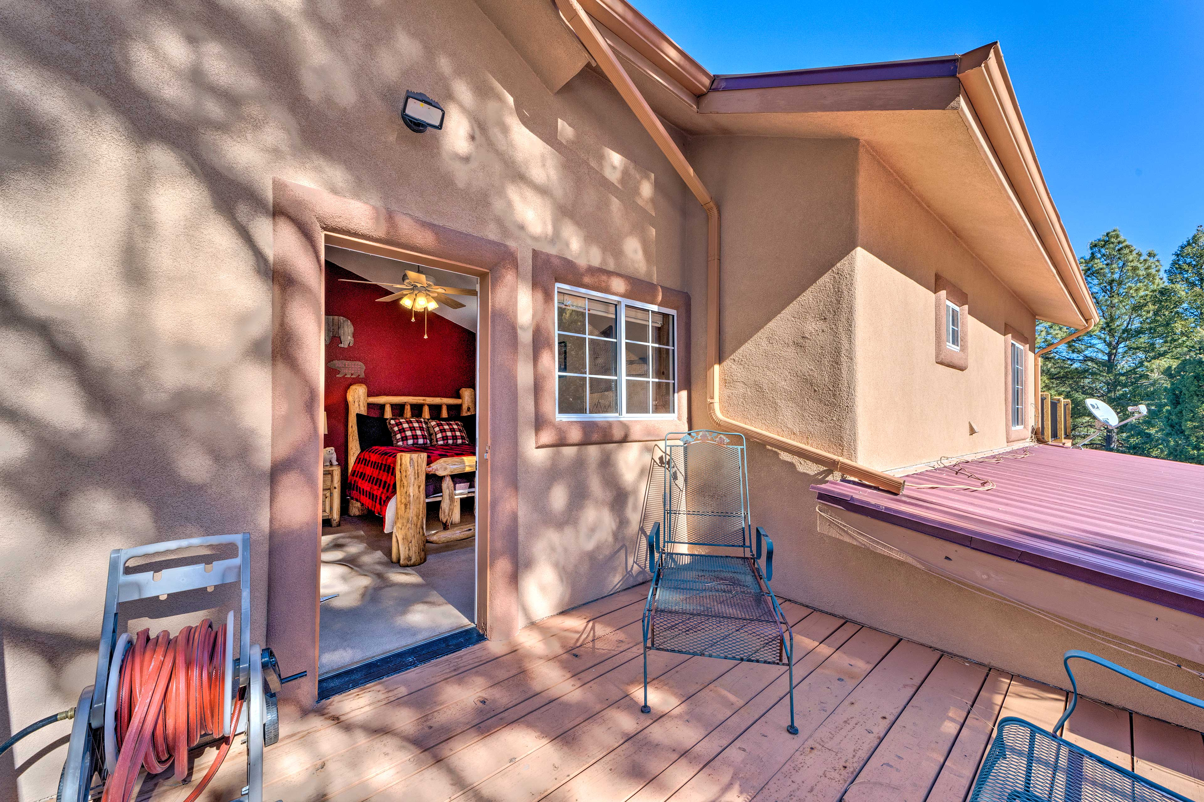 The second bedroom features direct deck access with seating!