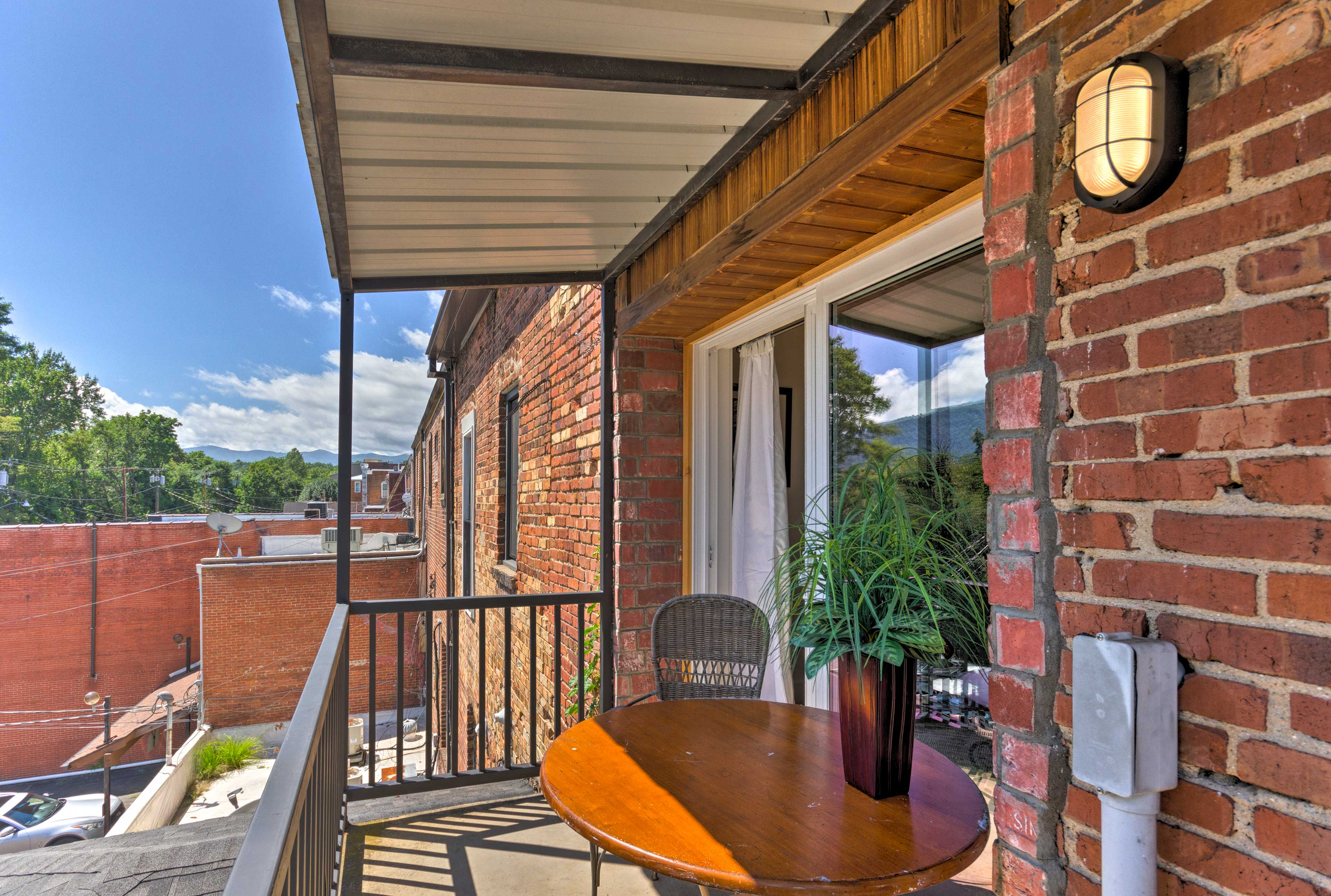 Begin mornings sipping coffee on the vacation rental's mountain-view balcony!