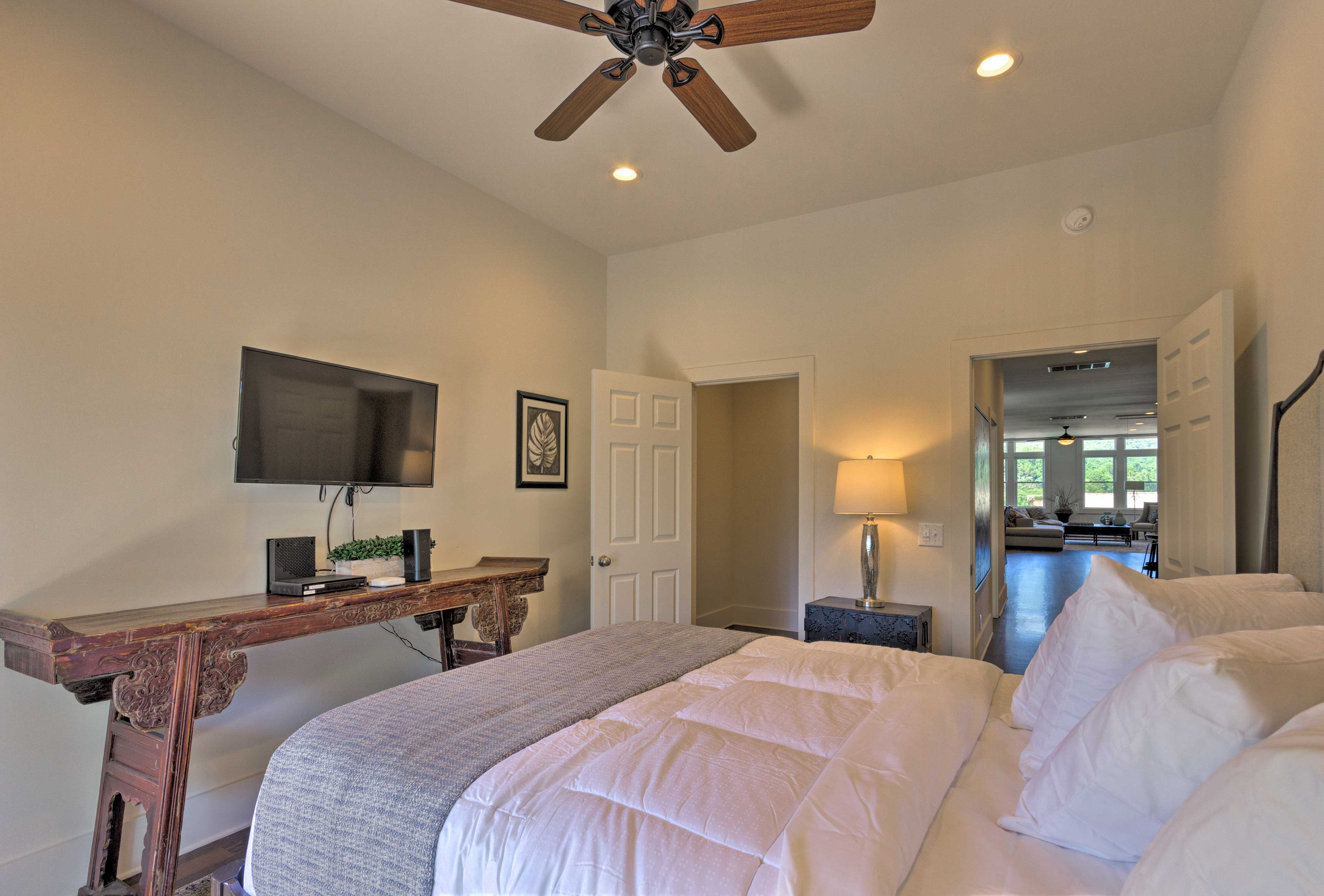 The master bedroom debuts a queen-sized bed & flat-screen TV.