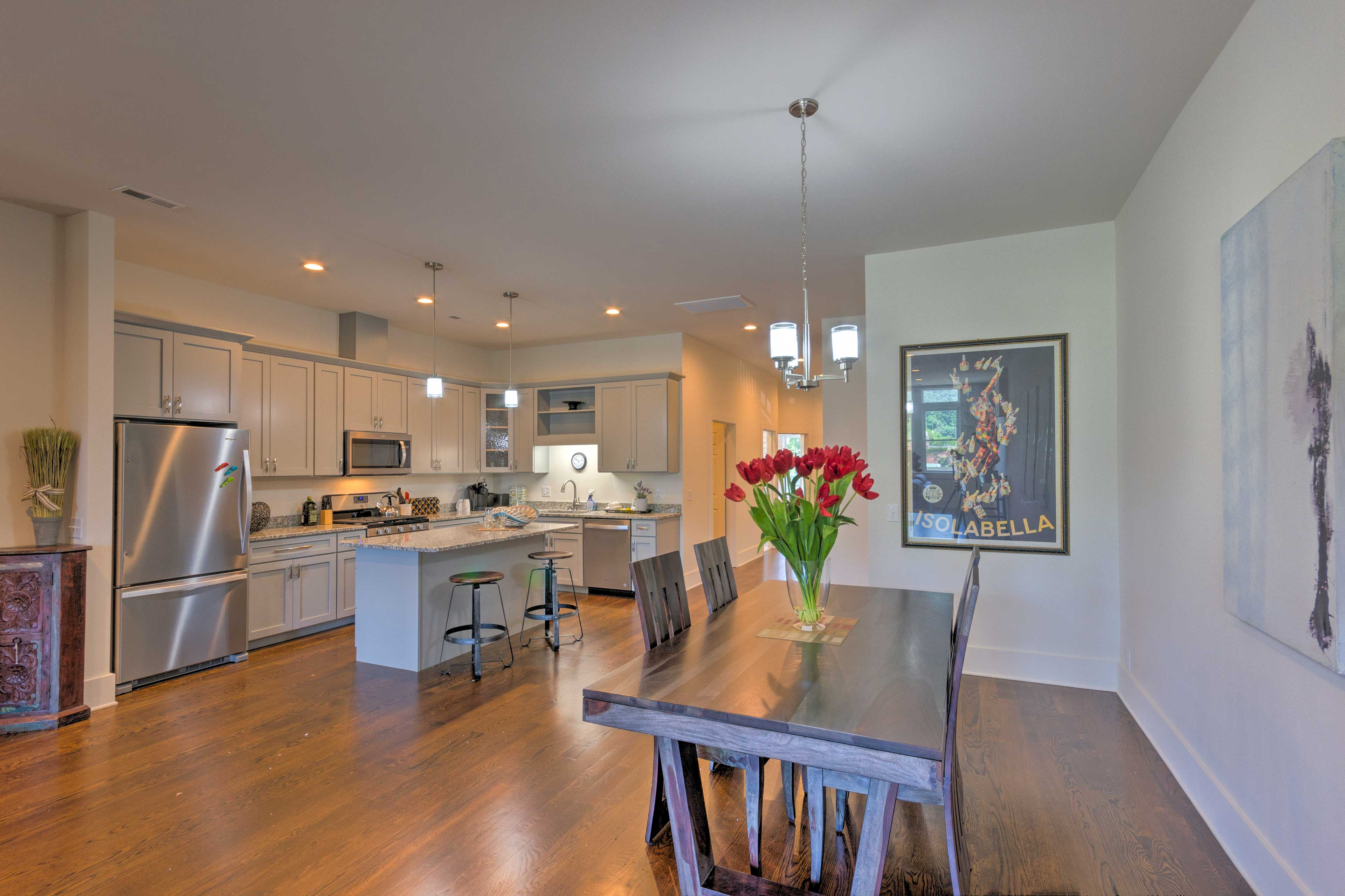 The downtown unit offers a full kitchen and spacious living area.