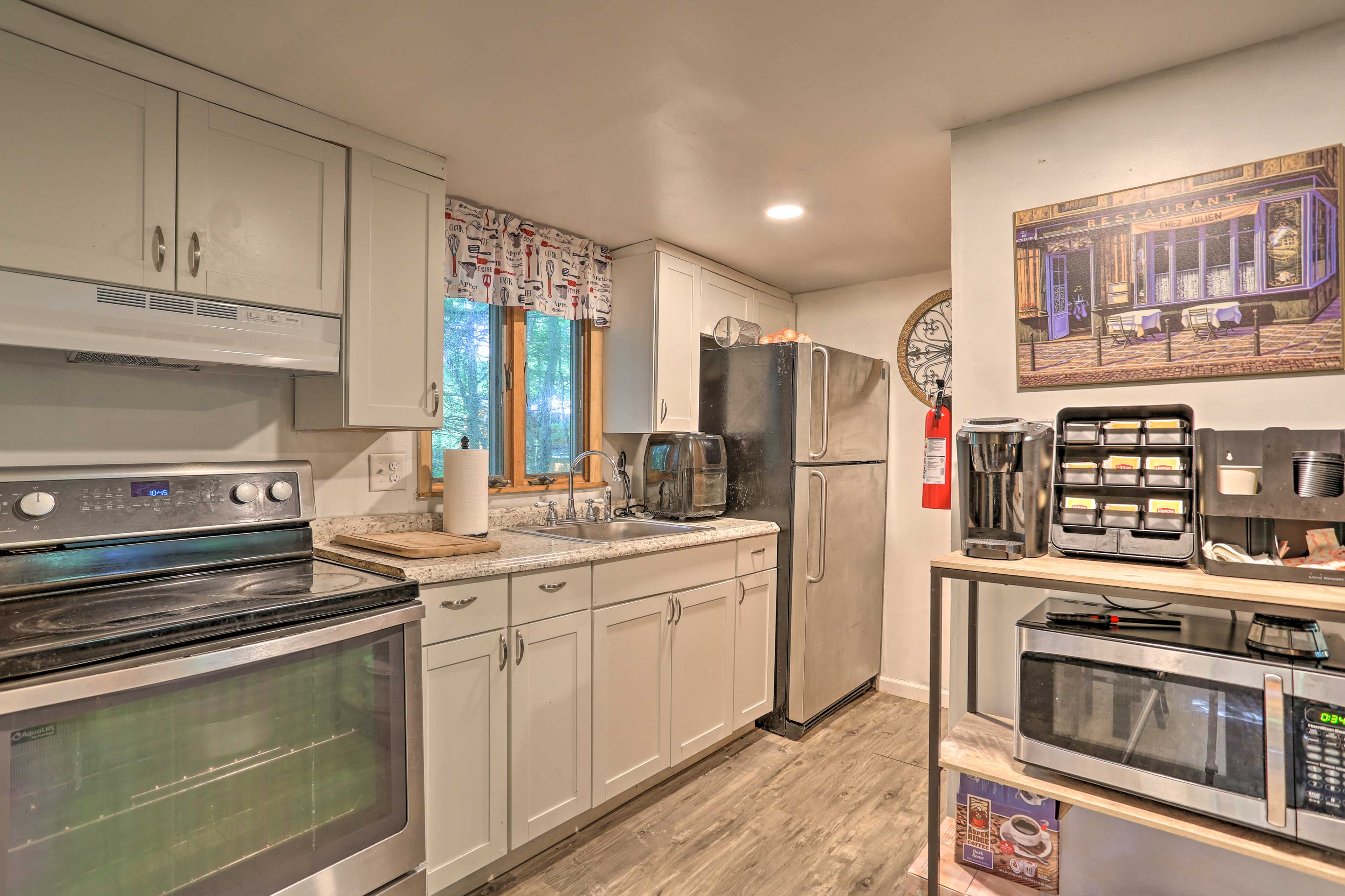 The kitchen has stainless steel appliances for the at-home chef.