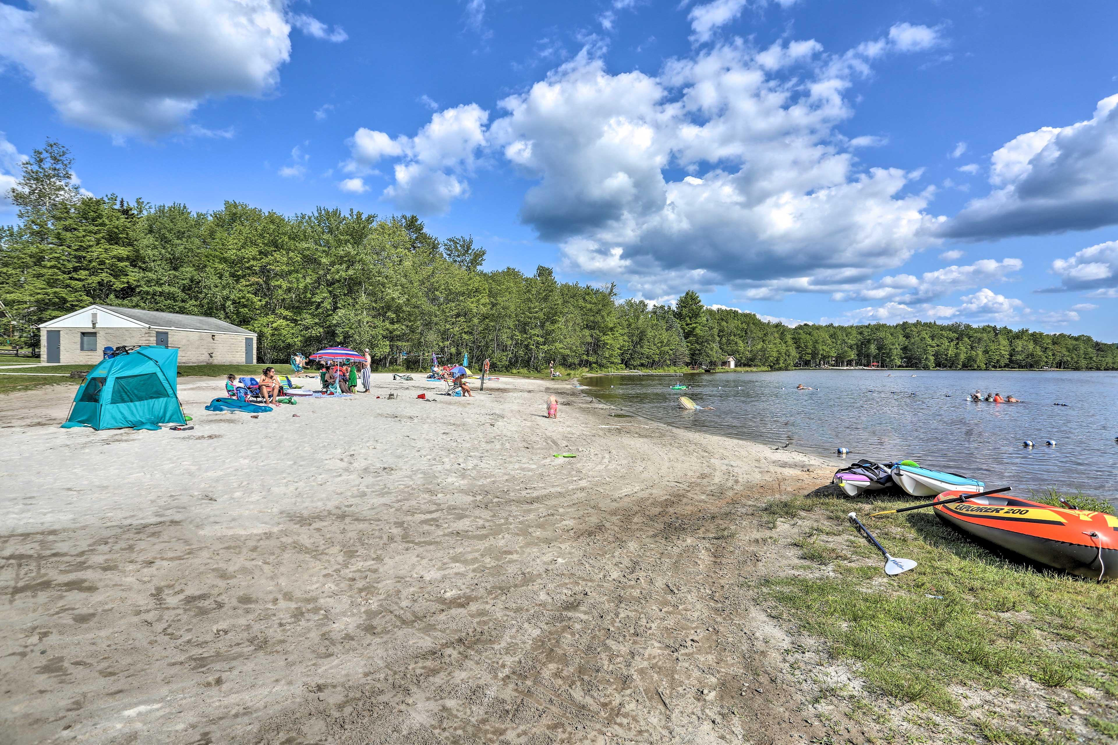 The beach area has a designated swimming area.