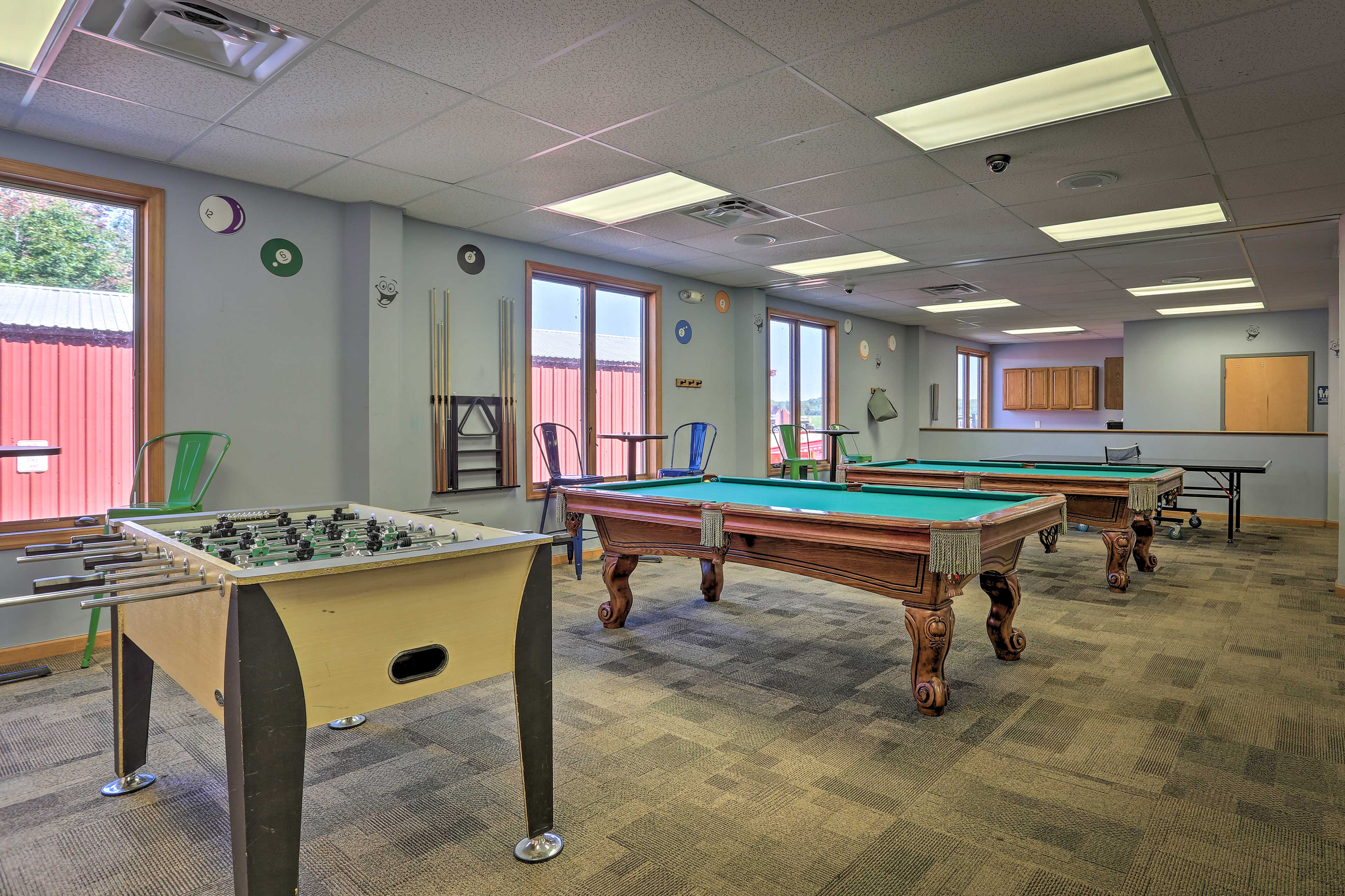 Challenge someone to a game of pool in the game room.