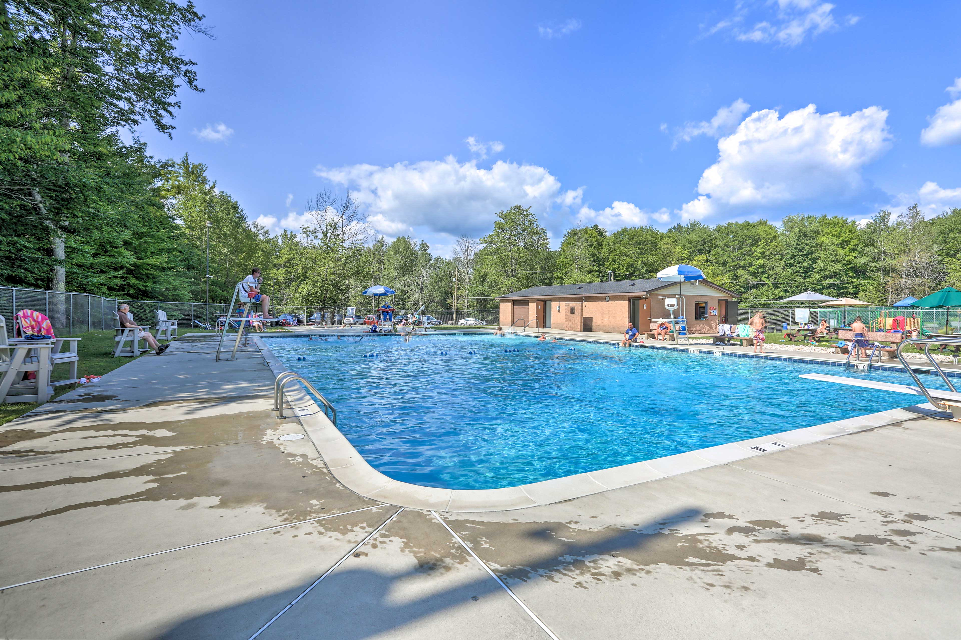 Sit by the poolside and enjoy this vacation rental's community perks!