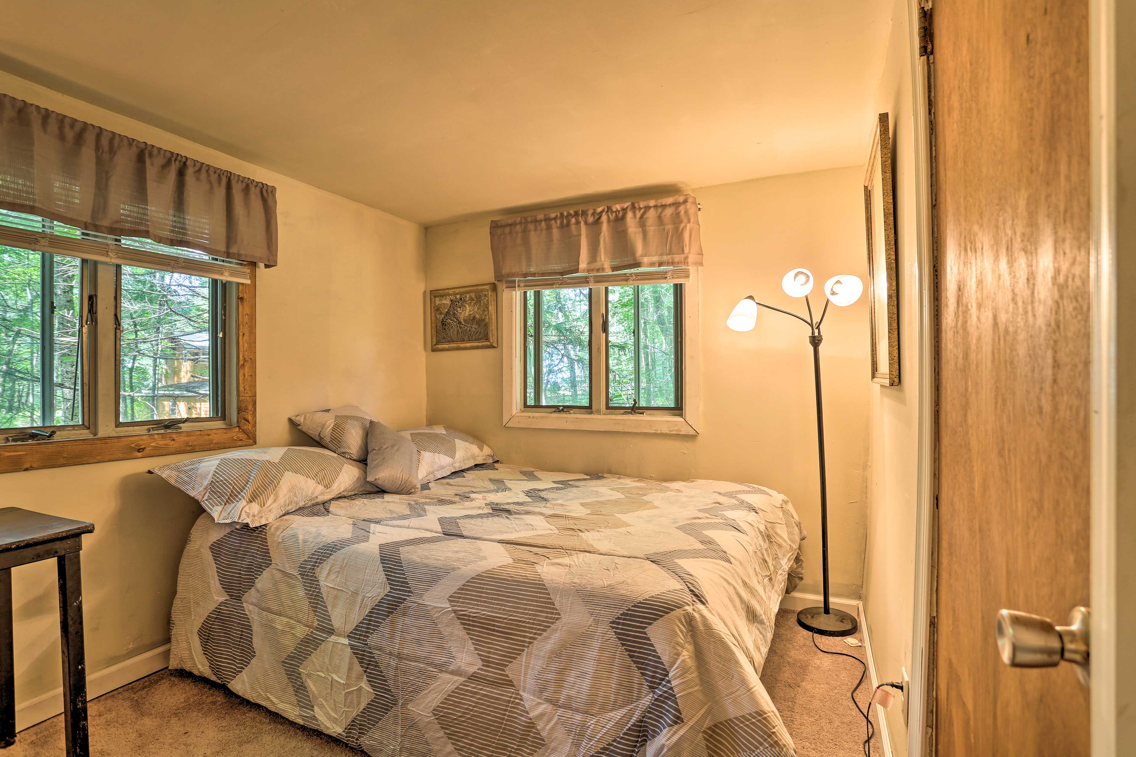 The master bedroom features a full-sized bed.