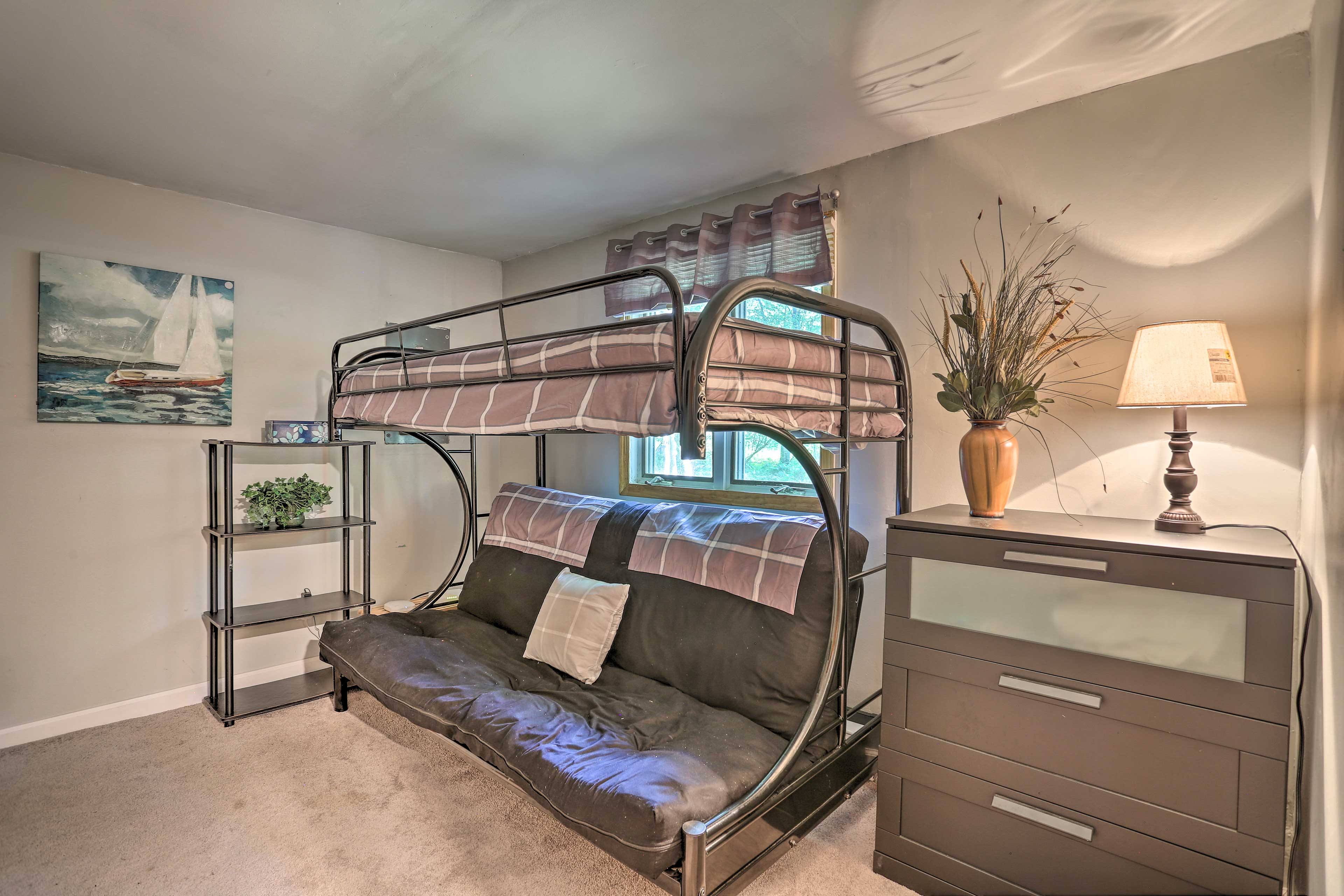 The second bedroom features a twin/full bunk bed.