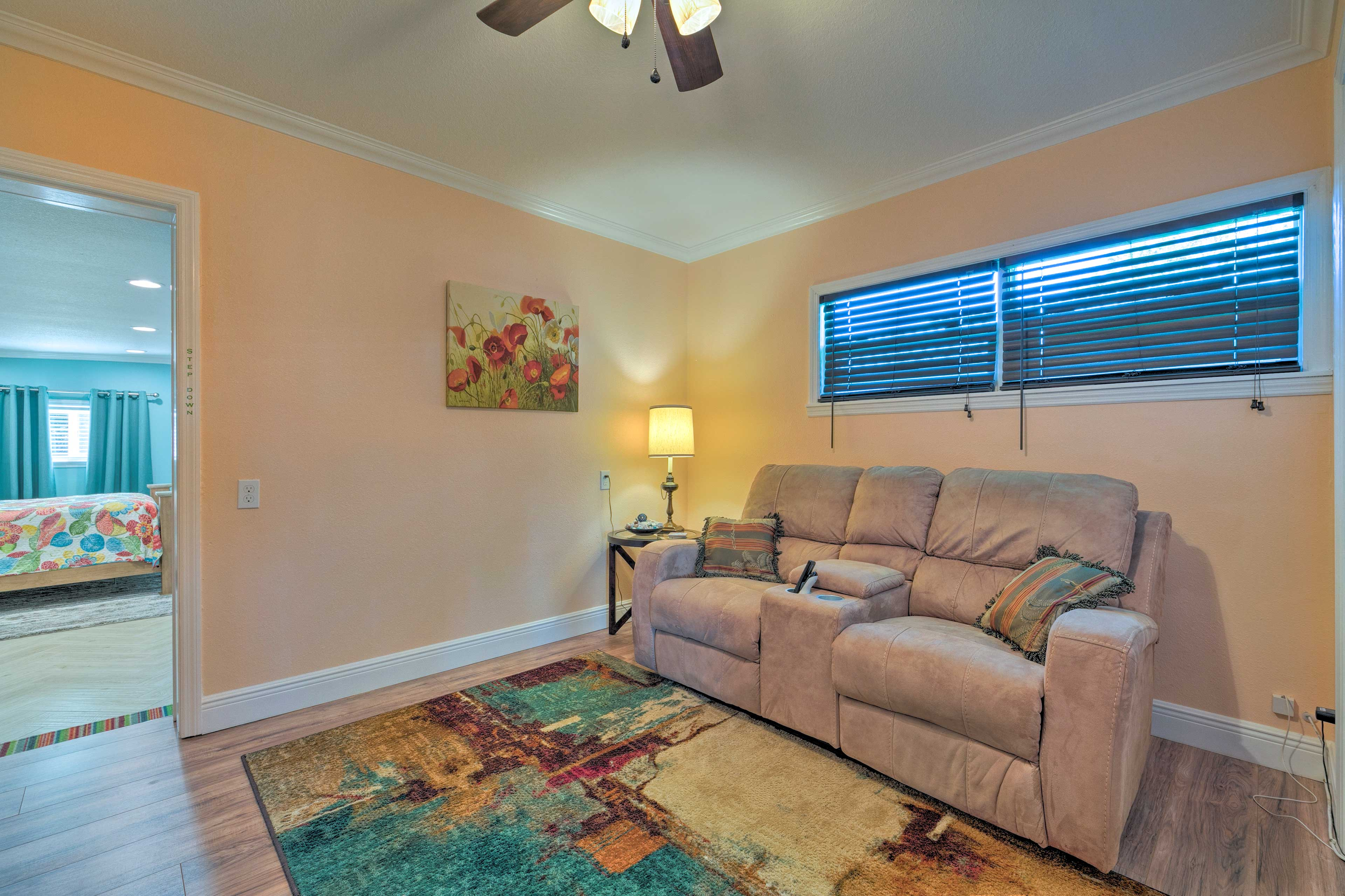 The movie room boasts comfy seating and a TV.